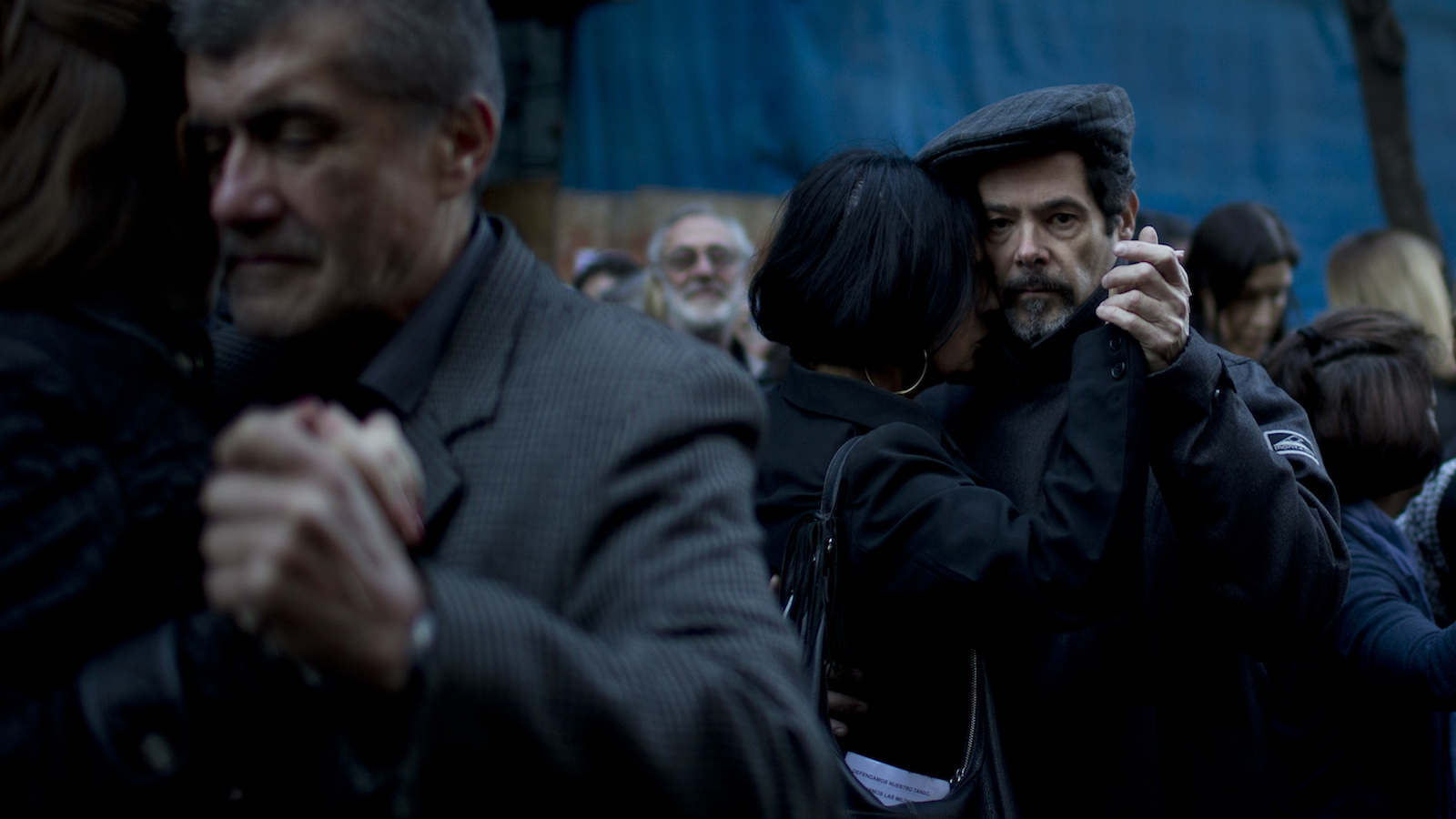 Couples dance a tango on a street in Buenos Aires, Argentina, Tuesday, July