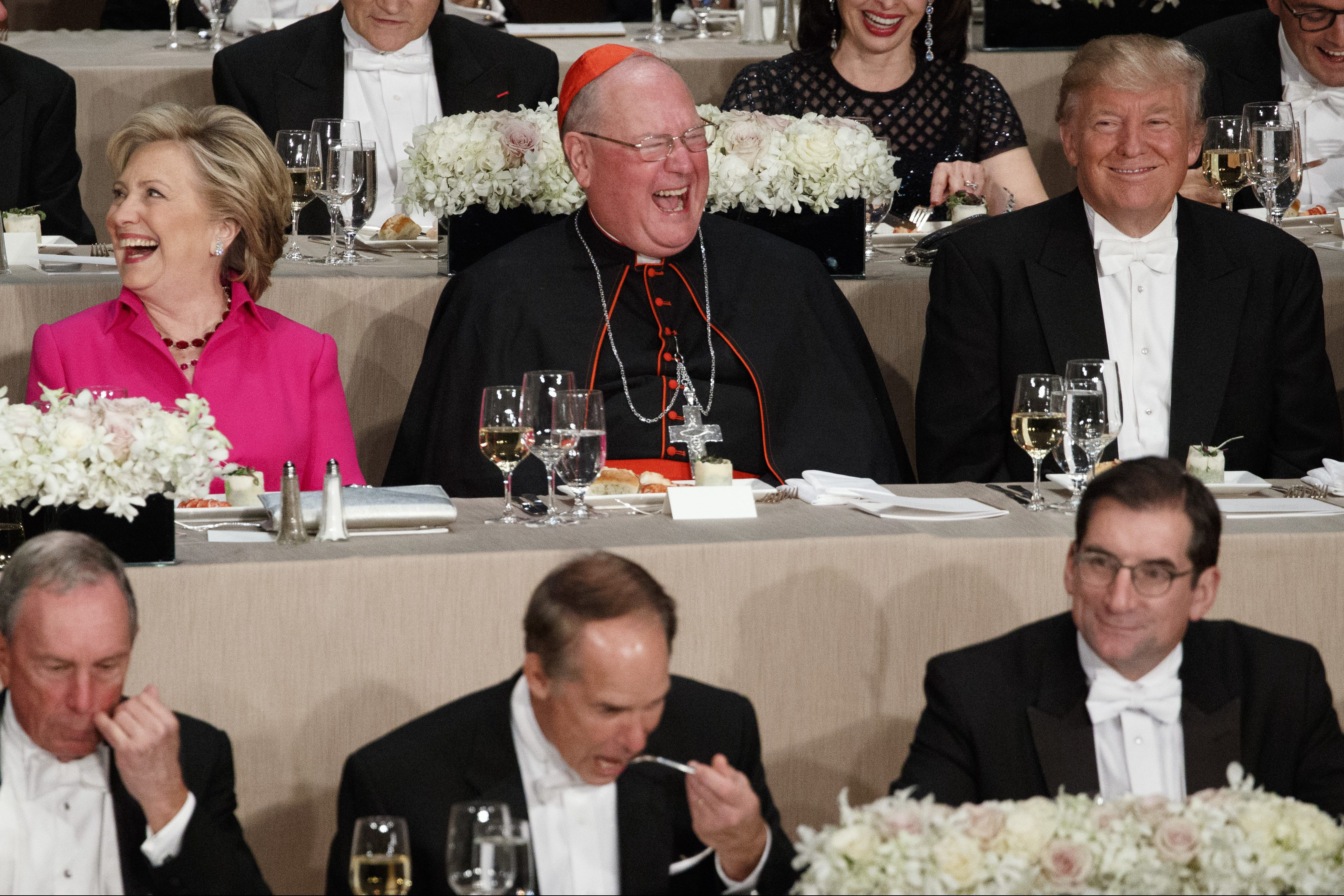 Republican presidential candidate Donald Trump, right, laughs at a joke with Cardinal Timothy Dolan, center, and Democratic presidential candidate Hillary Clinton during the Alfred E. Smith Memorial Foundation dinner, Thursday, Oct. 20, 2016, in New York.
