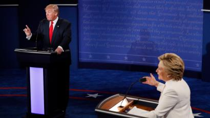 Democratic presidential nominee Hillary Clinton and Republican presidential nominee Donald Trump debate during the third presidential debate at UNLV in Las Vegas, Wednesday, Oct. 19, 2016. (Mark Ralston/Pool via AP)