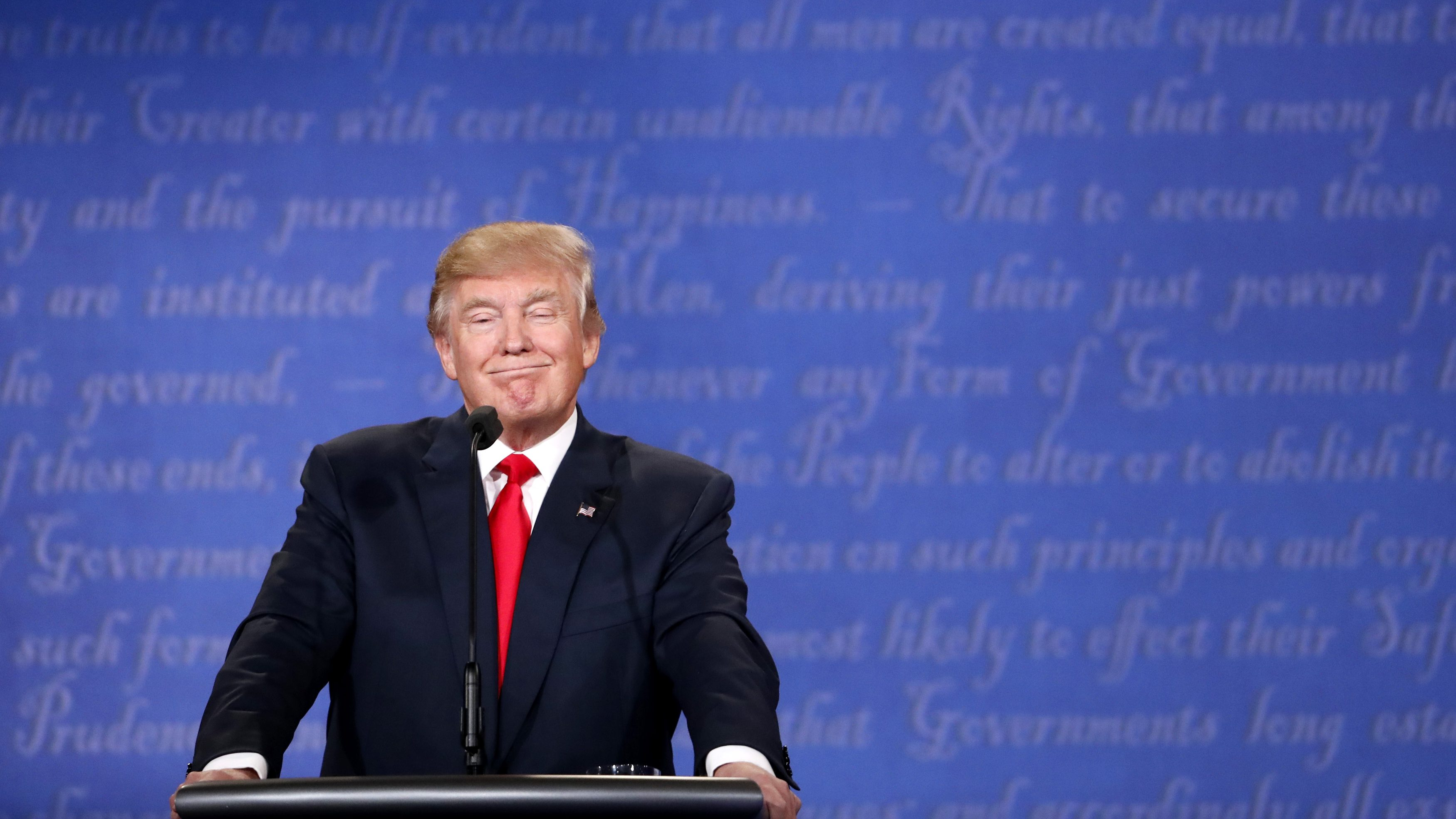 Republican U.S. presidential nominee Donald Trump smiles during the third and final debate with Democratic nominee Hillary Clinton.