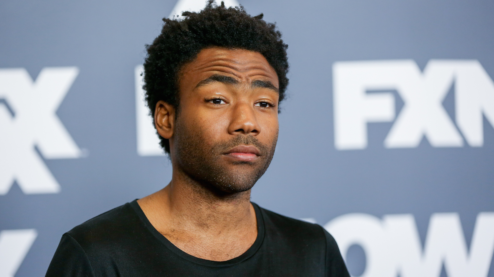 """Donald Glover, a cast member in the television series """"Atlanta,"""" arrives at the FX Television Critics Association summer press tour on Tuesday, Aug. 9, 2016, in Beverly Hills, Calif. (Photo by Rich Fury/Invision/AP)"""