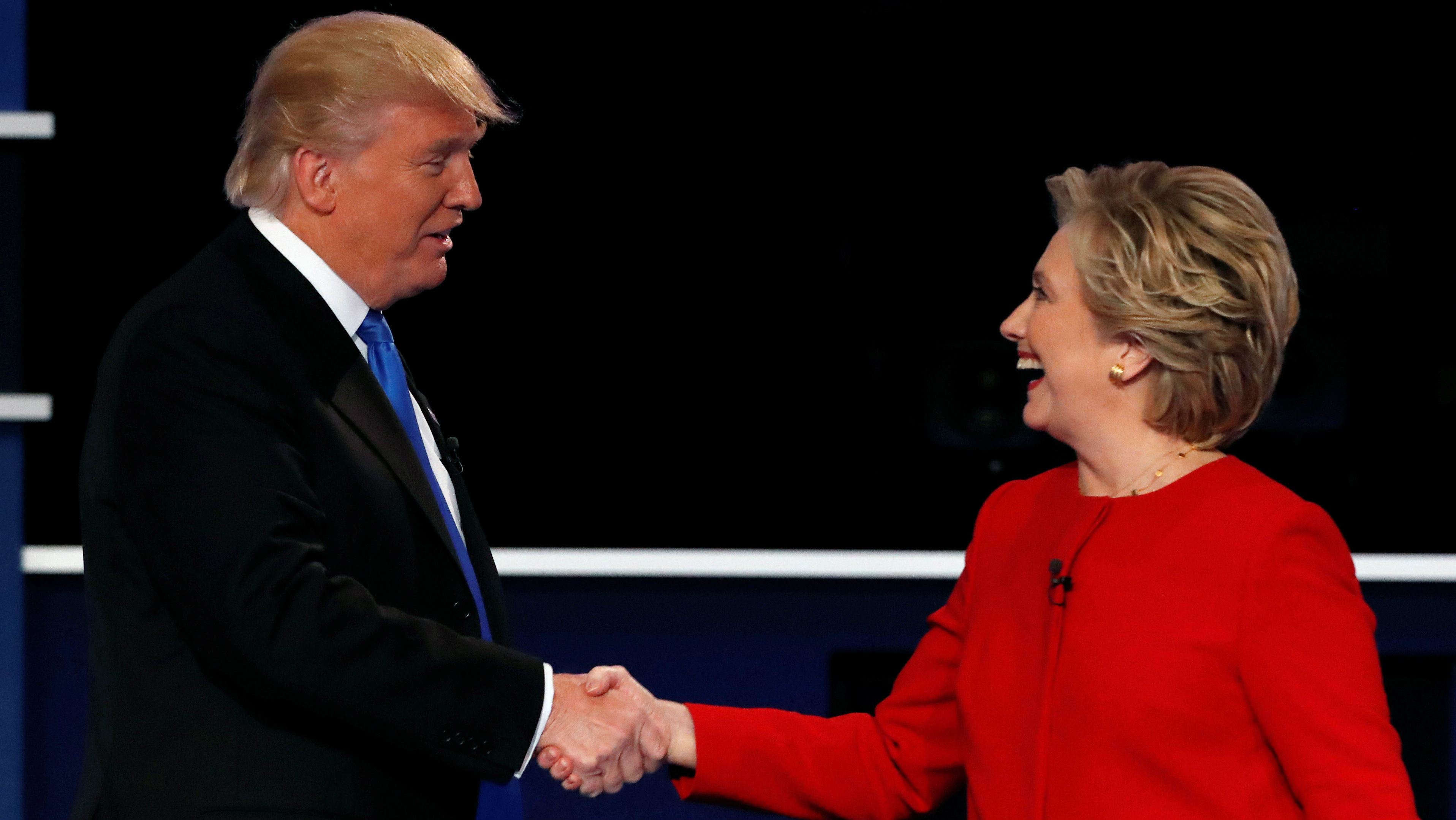 Republican U.S. presidential nominee Donald Trump and Democratic U.S. presidential nominee Hillary Clinton shake hands at the end of their first presidential debate at Hofstra University in Hempstead, New York, U.S., September 26, 2016.