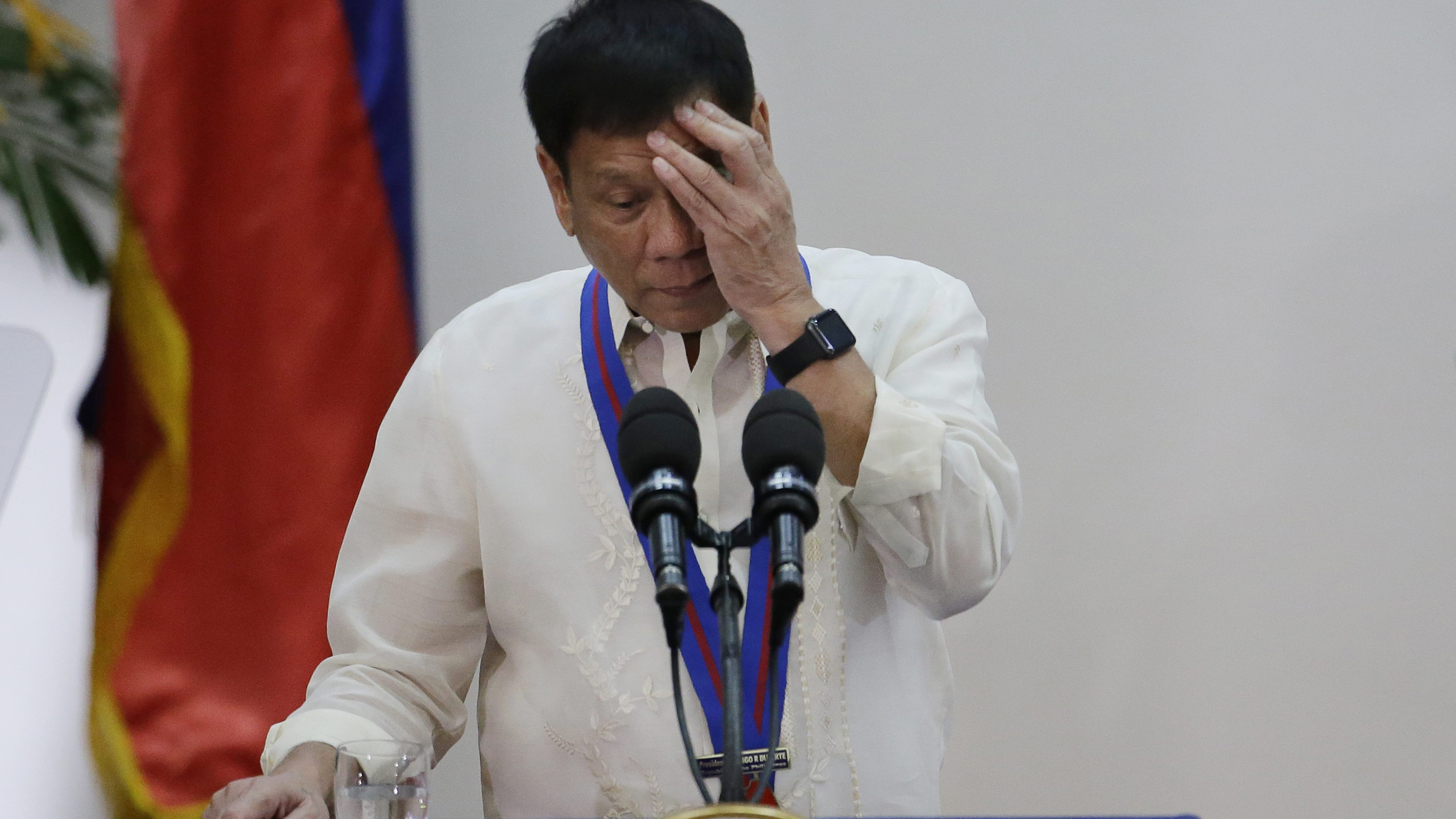 """Philippine President Rodrigo Duterte gestures during his speech at the """"Assumption of Command"""" right, of new Police Chief, Director General Ronald Dela Rosa at Camp Crame, Philippine National Police headquarters, in suburban Quezon city, Manila, Philippines on Friday, July 1, 2016. Duterte, who was sworn in as the Philippines' 16th president, has given himself a colossal campaign promise to fulfill, eradicating crime especially drug trafficking, smuggling, rapes and murder in three to six months."""