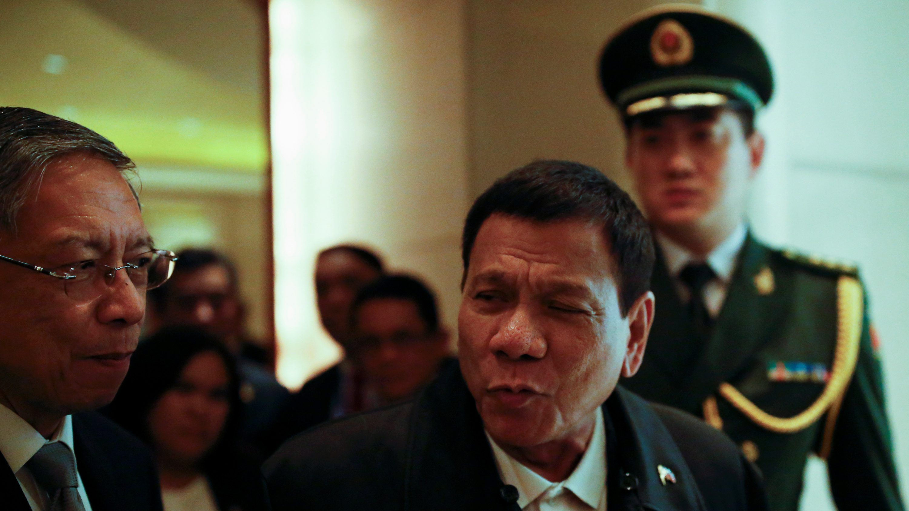 President of the Philippines Rodrigo Duterte (2nd R) arrives at a hotel in Beijing, China, October 18, 2016.  REUTERS/Thomas Peter - RTX2PC5X
