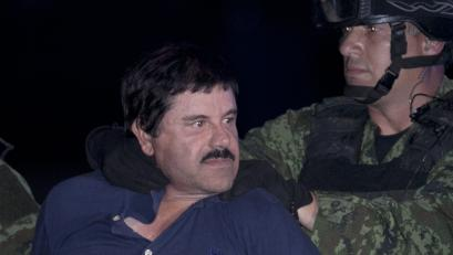 "In this Jan. 8, 2016 file photo, Joaquin ""El Chapo"" Guzman is made to face the press as he is escorted to a helicopter in handcuffs by Mexican soldiers and marines at a federal hangar in Mexico City, Mexico. Mexico's Foreign Relations department has ruled that the extradition of Guzman to the United States can go forward. The department said Friday, May 20, 2016 that the U.S. had guaranteed that Guzman would not face the death penalty, which is not applied in Mexico. The process can be appealed."