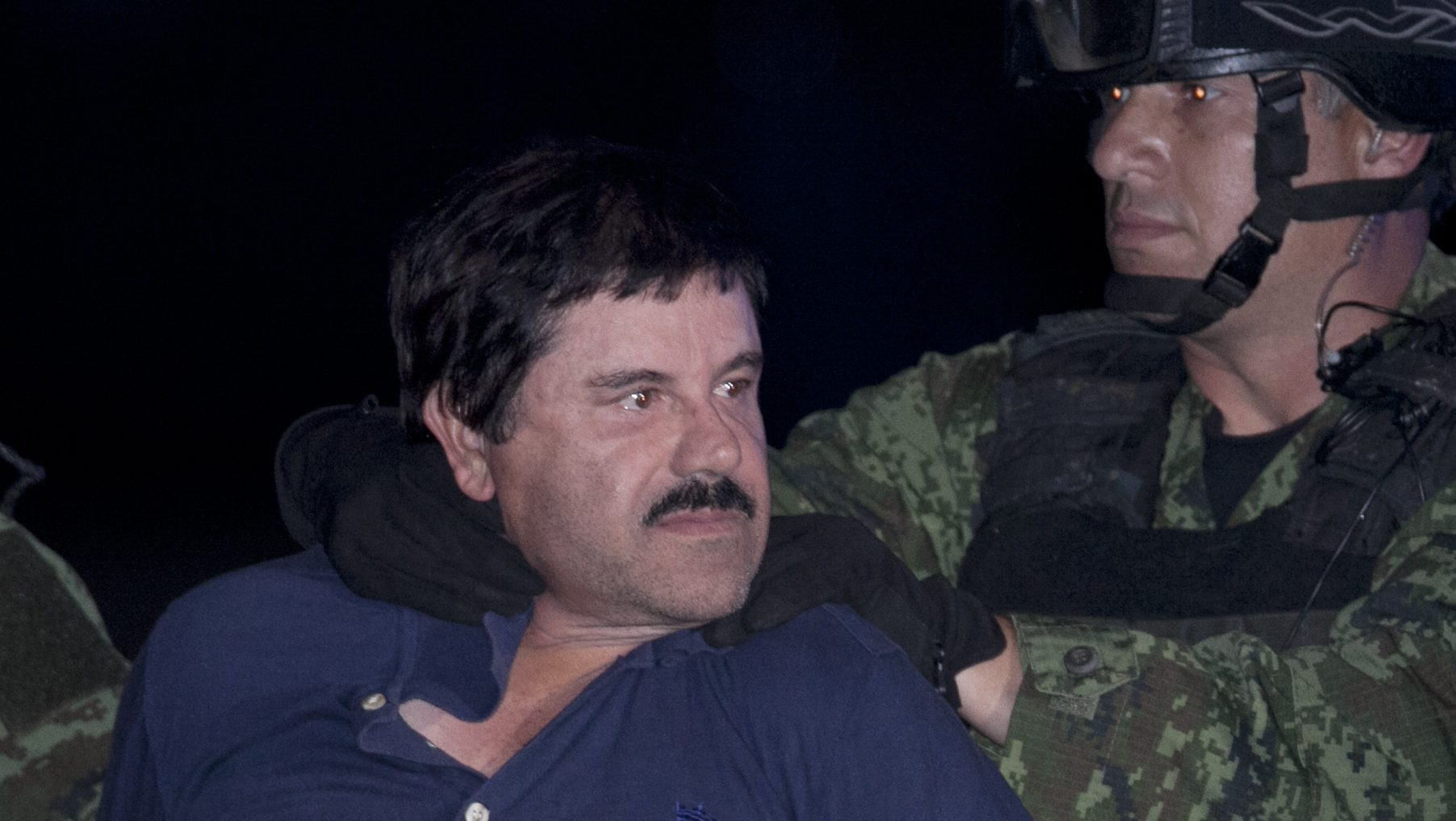 """In this Jan. 8, 2016 file photo, Joaquin """"El Chapo"""" Guzman is made to face the press as he is escorted to a helicopter in handcuffs by Mexican soldiers and marines at a federal hangar in Mexico City, Mexico. Mexico's Foreign Relations department has ruled that the extradition of Guzman to the United States can go forward. The department said Friday, May 20, 2016 that the U.S. had guaranteed that Guzman would not face the death penalty, which is not applied in Mexico. The process can be appealed."""