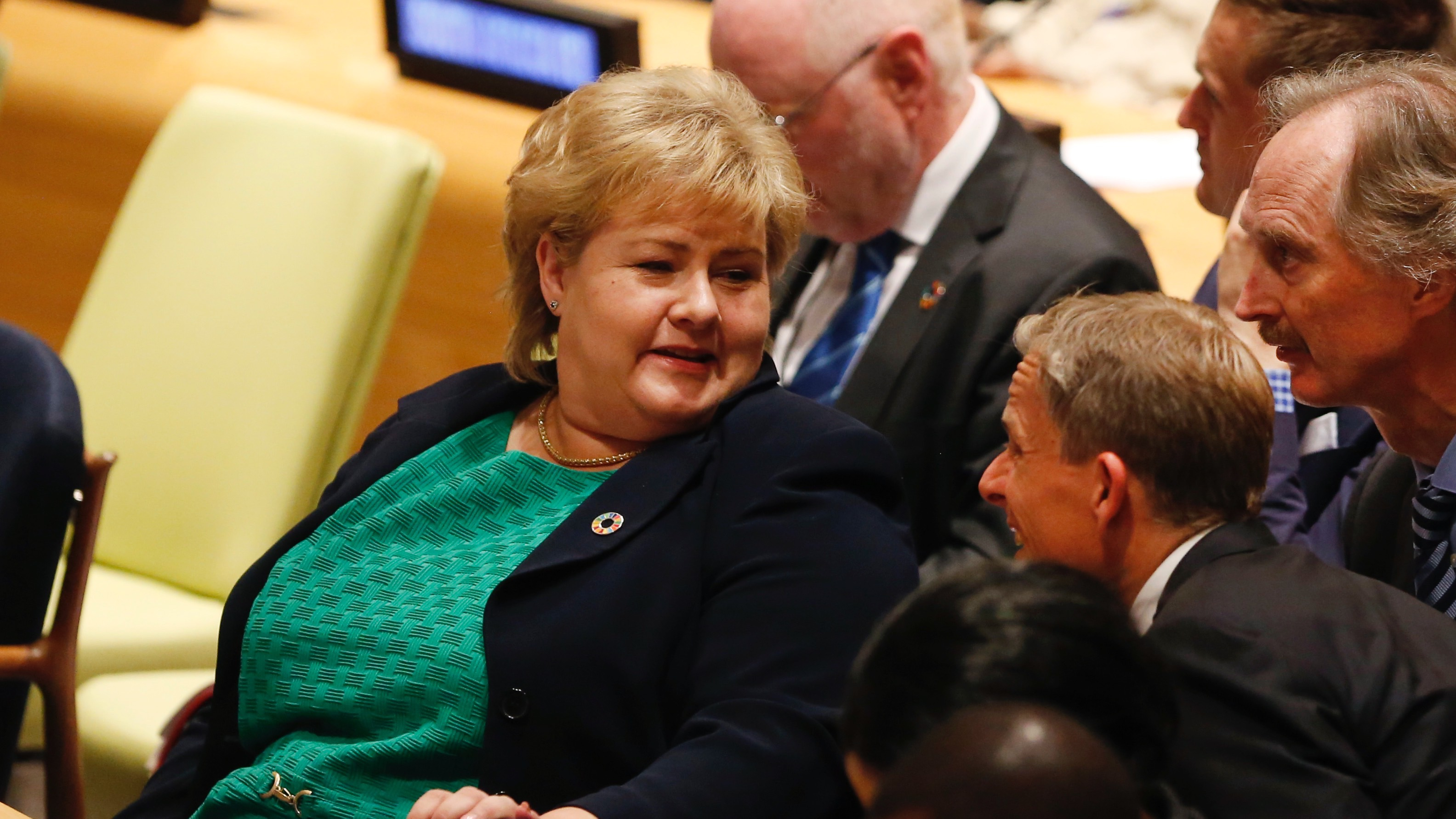Prime Minister Erna Solberg, left, attends a meeting on sustainable development Monday, July 18, 2016, at United Nations headquarters. (AP Photo/Mark Lennihan)