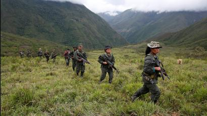 Members of the FARC patrol in the remote mountains of Colombia.