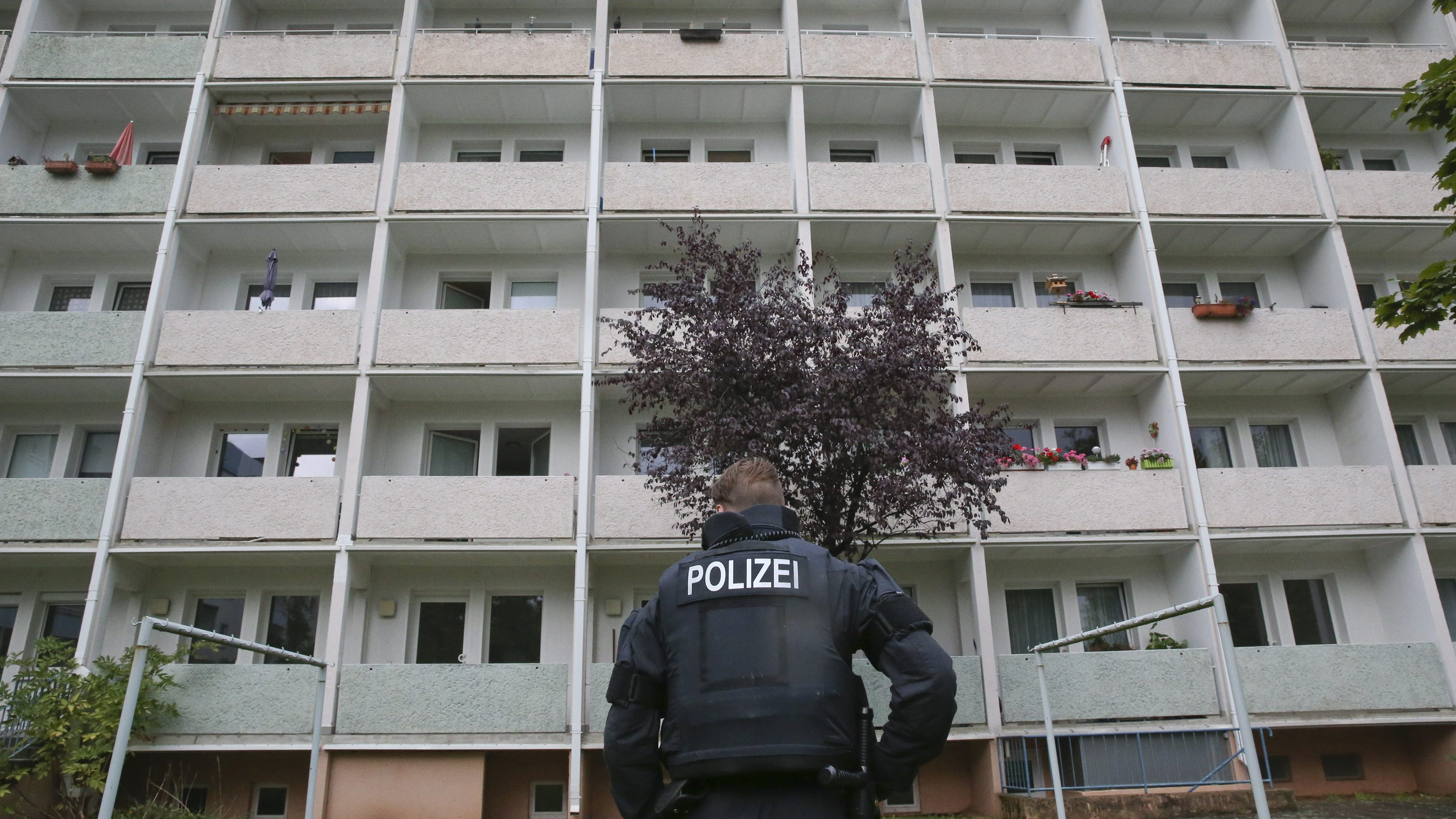 German policemen search a housing area in Chemnitz on suspicion that a bomb attack was being planned.