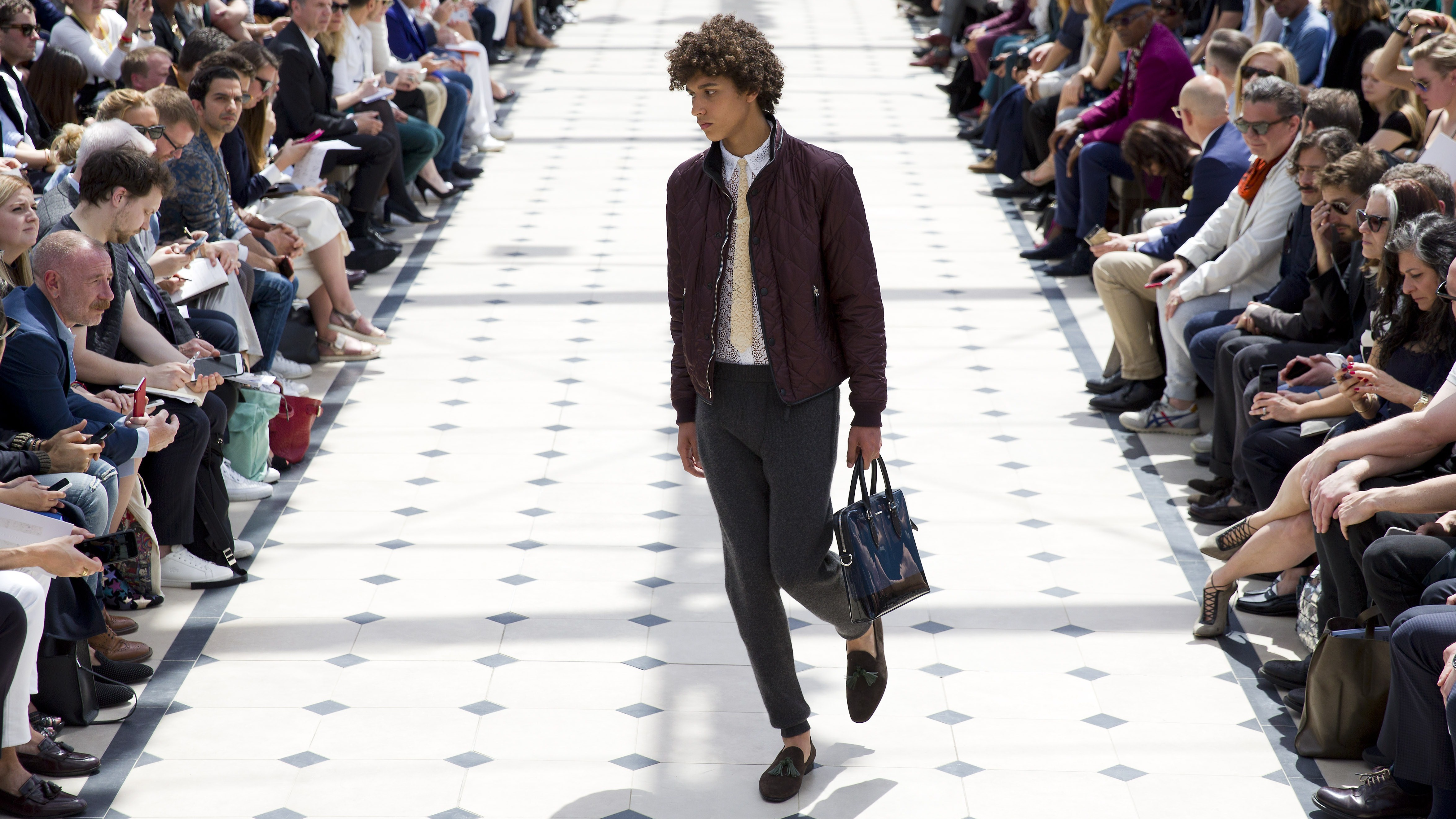 A model presents a creation by British design house Burberry Prorsum during their catwalk show on the fourth day of the Spring/Summer 2016 London Collections Men fashion event in central London, on June 15, 2015. AFP PHOTO / JUSTIN TALLIS (Photo credit should read JUSTIN TALLIS/AFP/Getty Images)