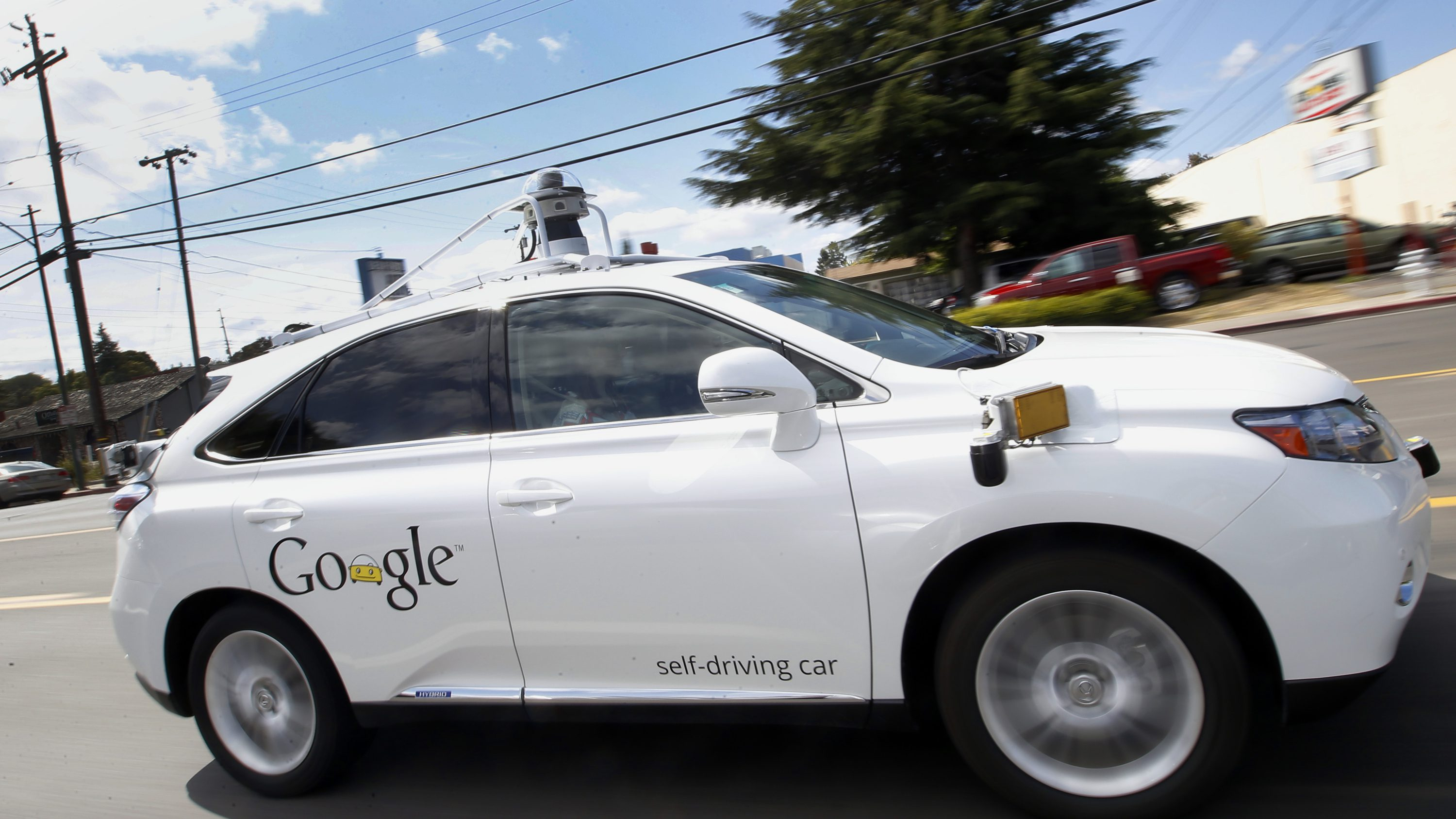 Google's self-driving Lexus drives along a street in Mountain View, California.