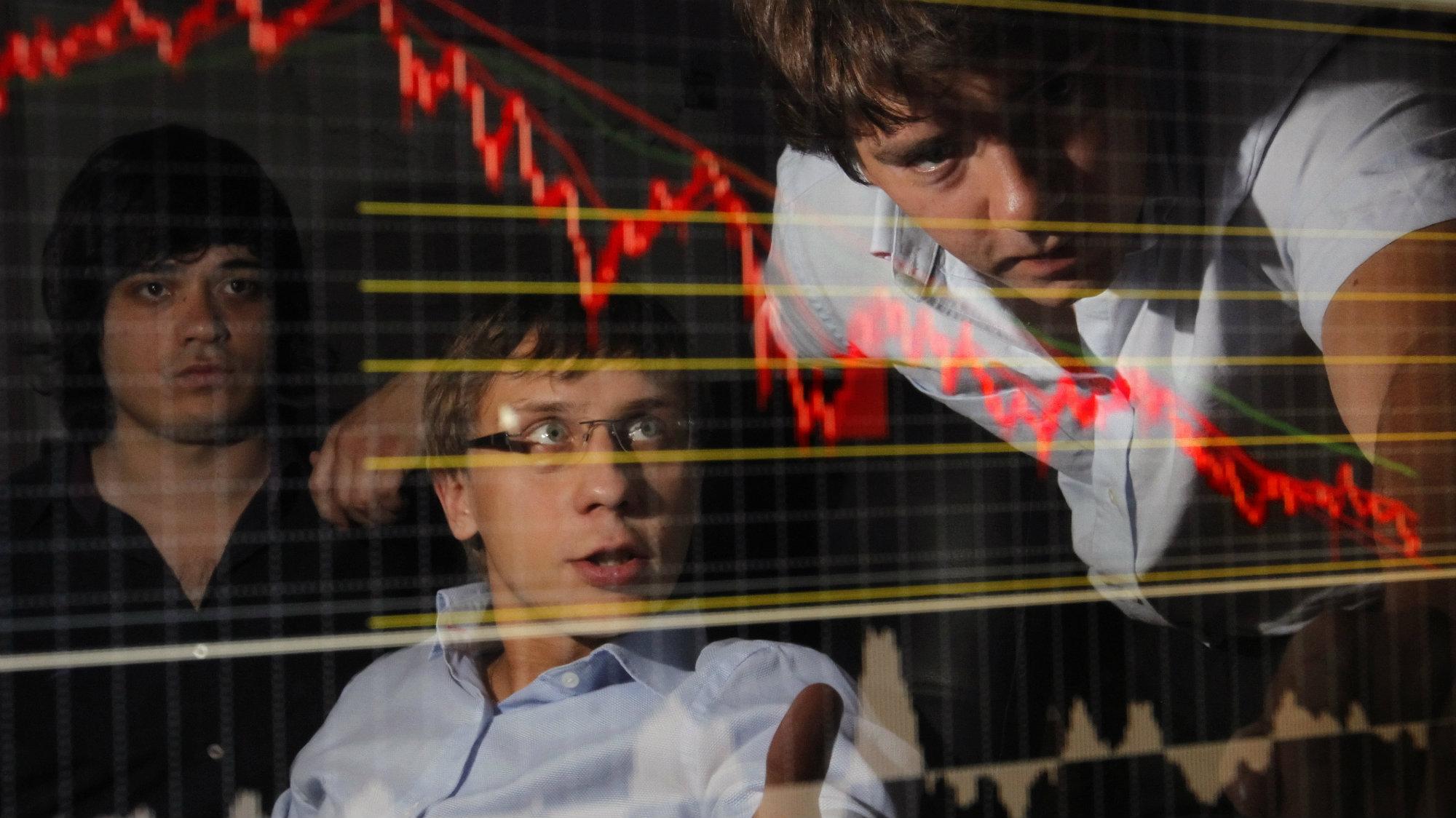 Traders looking at a screen.