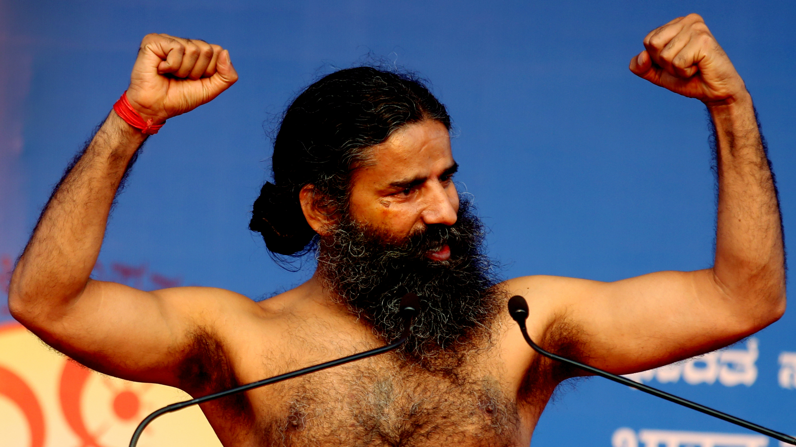 Indian Yoga guru Baba Ramdev take part in the free yoga camp for yoga enthusiasts, in Bangalore, India, 19 March 2016. Over hundreds of yoga enthusiast performed sun salutations, Pranayama (breathing exercise) and Asanas (body Postures) in order to raise awareness among the people for Happiness, Harmony and Good Health adds life to years. The camp will run from 19th to 23rd March 2016.