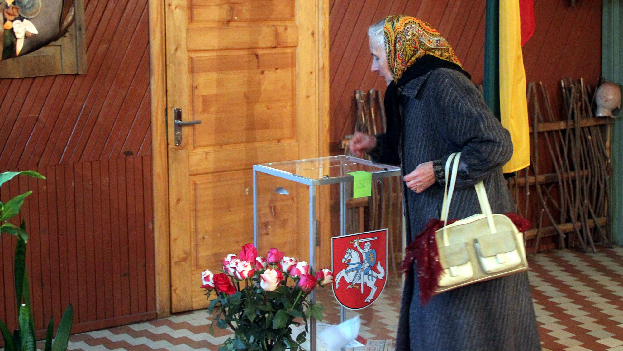 A woman vote during the second round of Lithuanian parliamentary election in Birzai, Lithuania, 23 October 2016.
