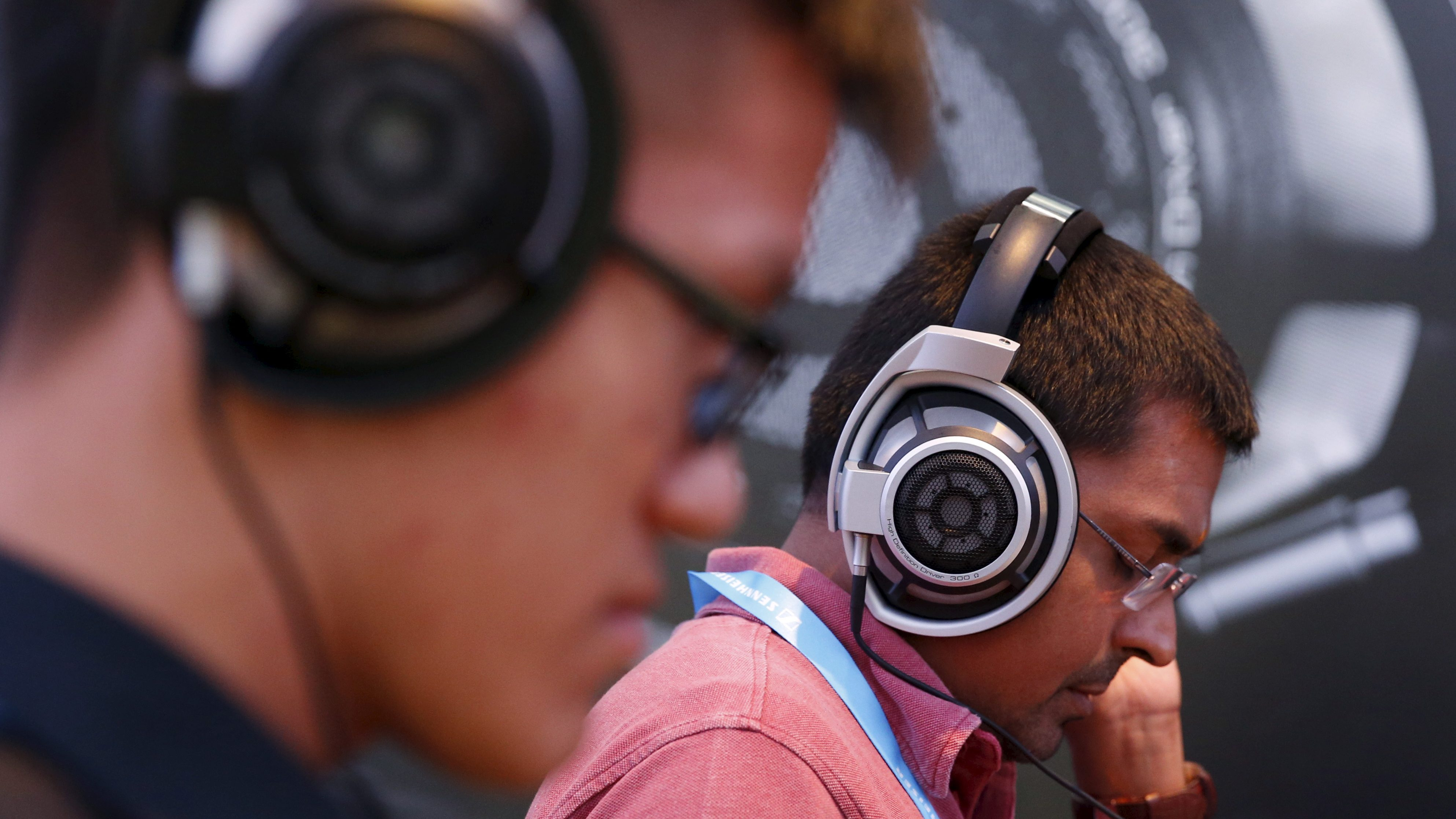 People test headphones during the CanJam headphone and personal audio expo in Singapore February 21, 2016.