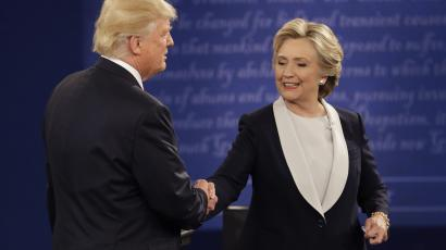 Republican presidential nominee Donald Trump and Democratic presidential nominee Hillary Clinton shakes following the second presidential debate at Washington University in St. Louis, Sunday, Oct. 9, 2016. (AP Photo/John Locher)