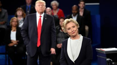 Democratic presidential nominee Hillary Clinton, right, and Republican presidential nominee Donald Trump listen to a question during the second presidential debate at Washington University in St. Louis, Sunday, Oct. 9, 2016.