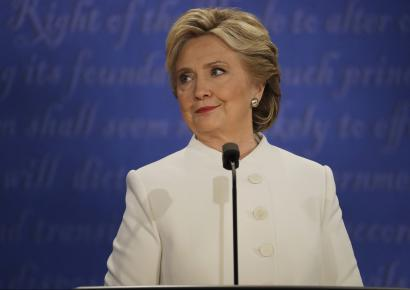 Democratic presidential nominee Hillary Clinton listens to Republican presidential nominee Donald Trump during the third presidential debate at UNLV in Las Vegas, Wednesday, Oct. 19, 2016.