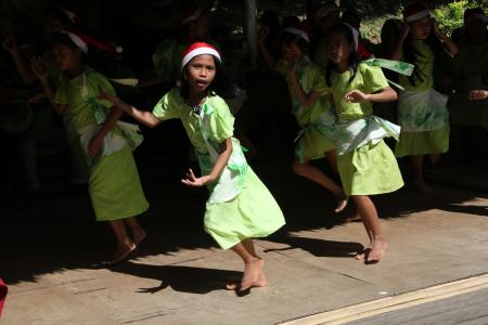 A group of children dance in a performance organzied by a local church to raise money after Typhoon Bopha on the island of Bohol in the Philippines.