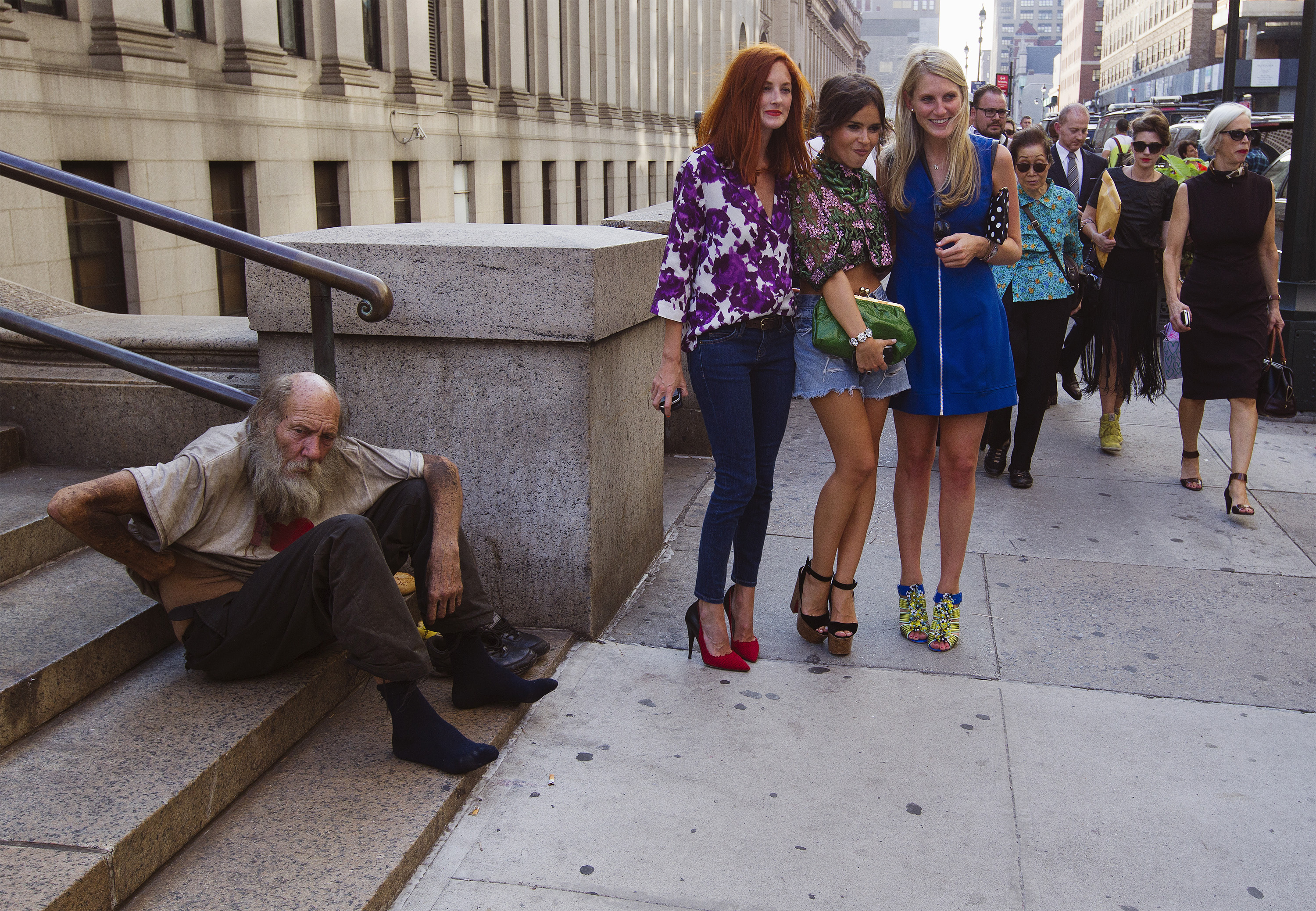 Fashionistas ignore homeless man on NYC sidewalk