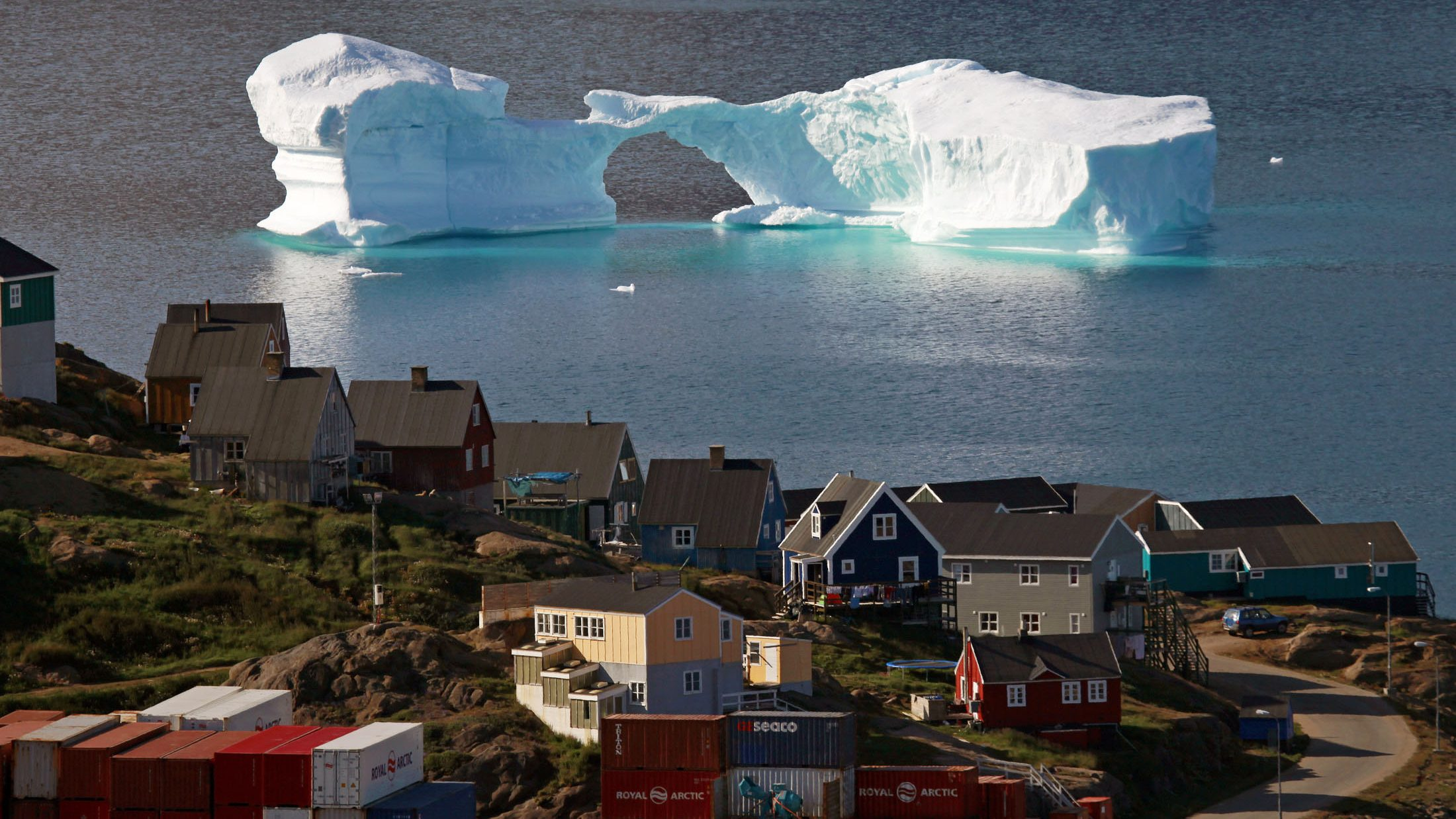 An iceberg floats near a harbour in the town of Kulusuk, east Greenland.