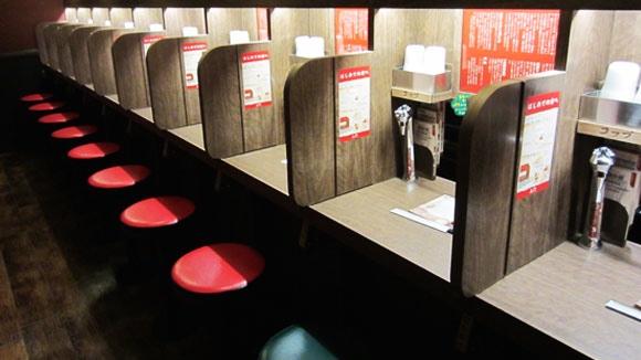 Flavor concentration booths for slurping noodles in solitude.