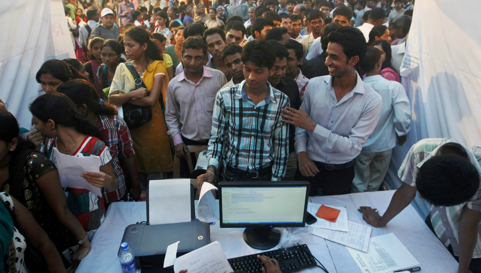 Indian youths seeking jobs crowd a job fair in Mumbai, India, Wednesday, Oct. 12, 2011.