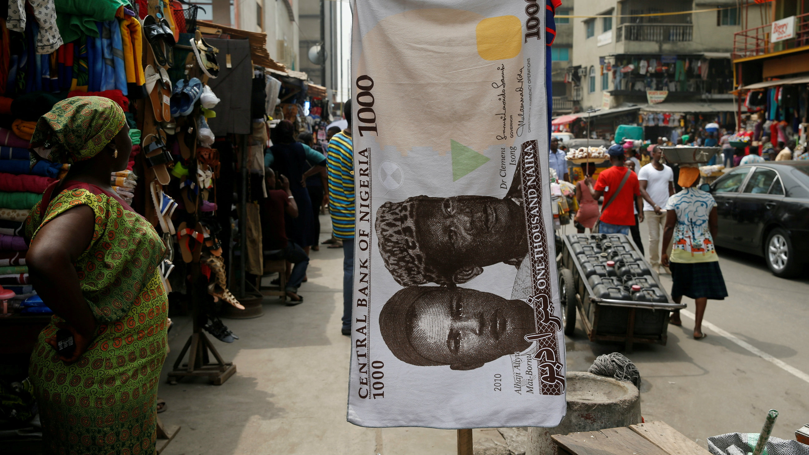 A towel with a print of the Nigerian naira is displayed for sale at a street market in the central business district of Lagos, Nigeria, February 4, 2016.