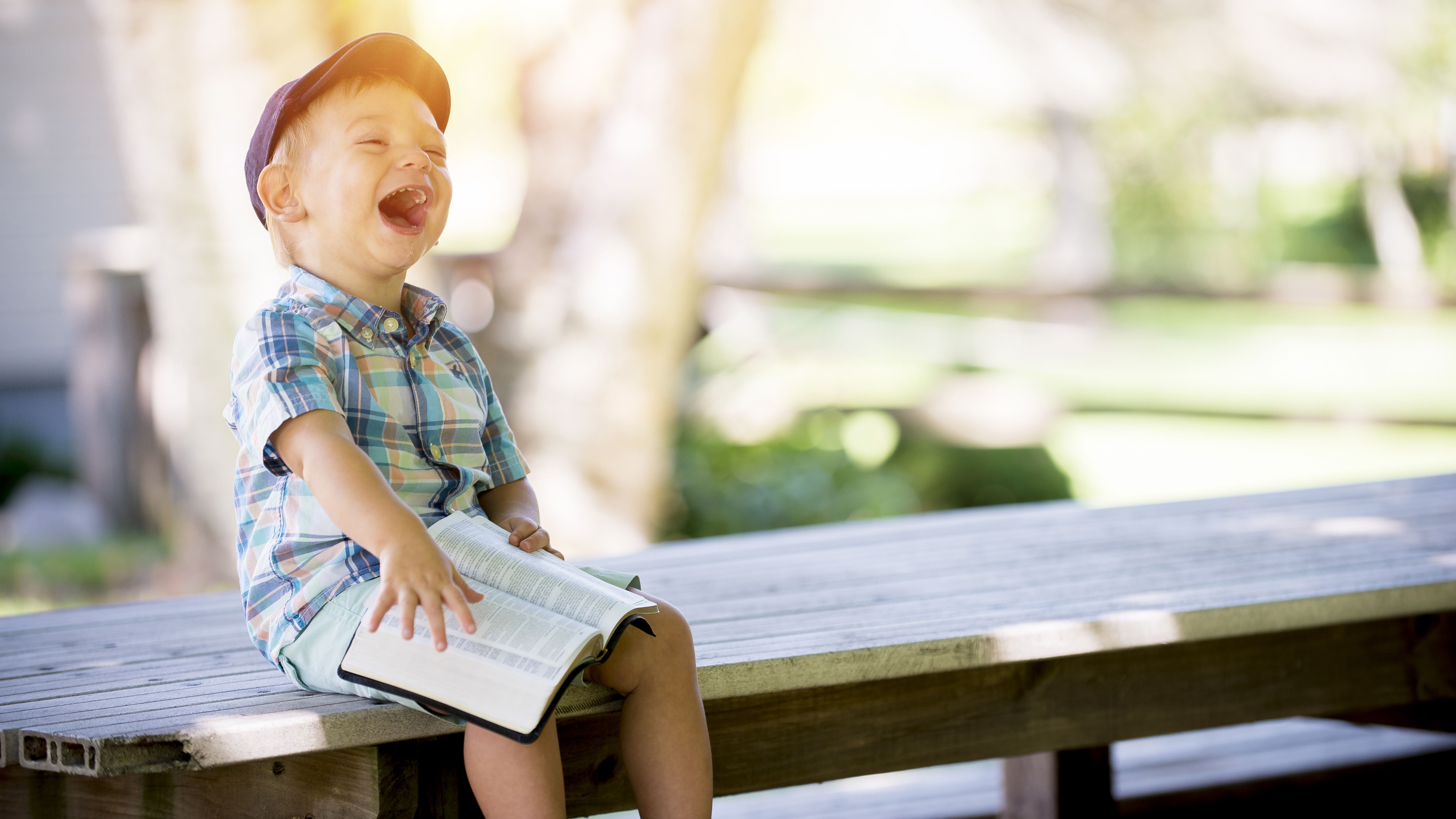 laughing-child-with-book-edit