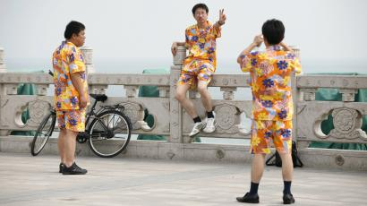 Men vacationing in funny outfits