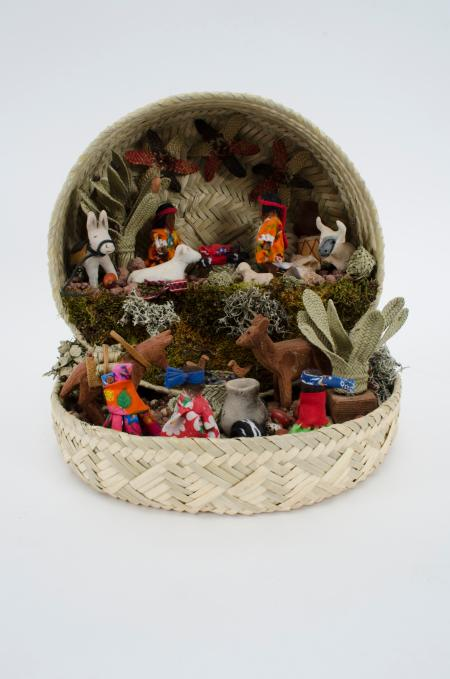 Mexican nativity scene in a basket.