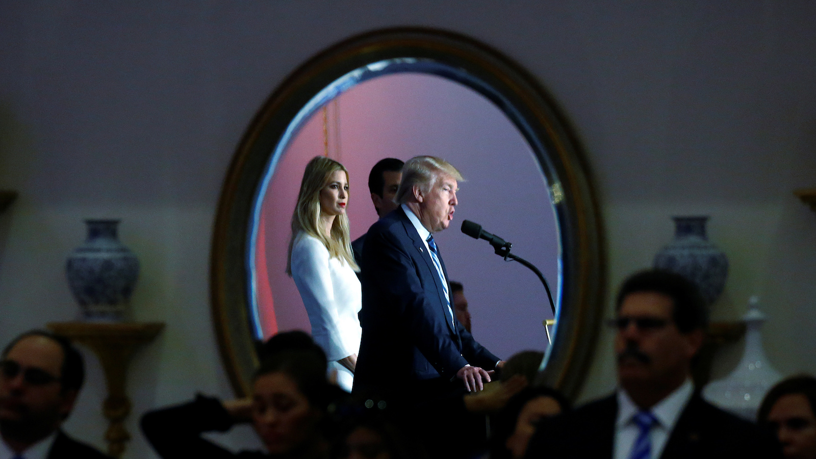 Republican presidential nominee Donald Trump and his daughter Ivanka Trump are reflected in a mirror as they attend a campaign event in Washington, DC, U.S., October 26, 2016. REUTERS/Carlo Allegri - RTX2QKUC