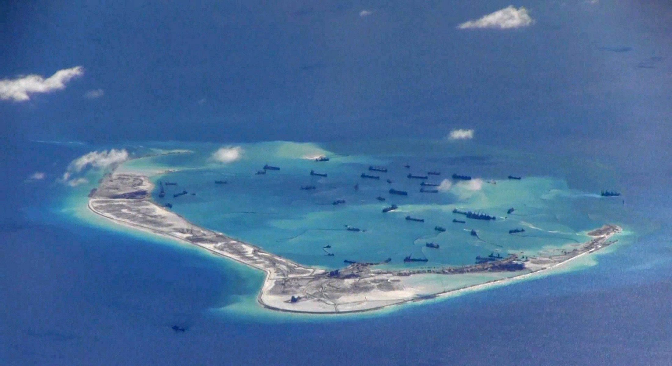 Mischief Reef in the South China Sea, with dredging ships.