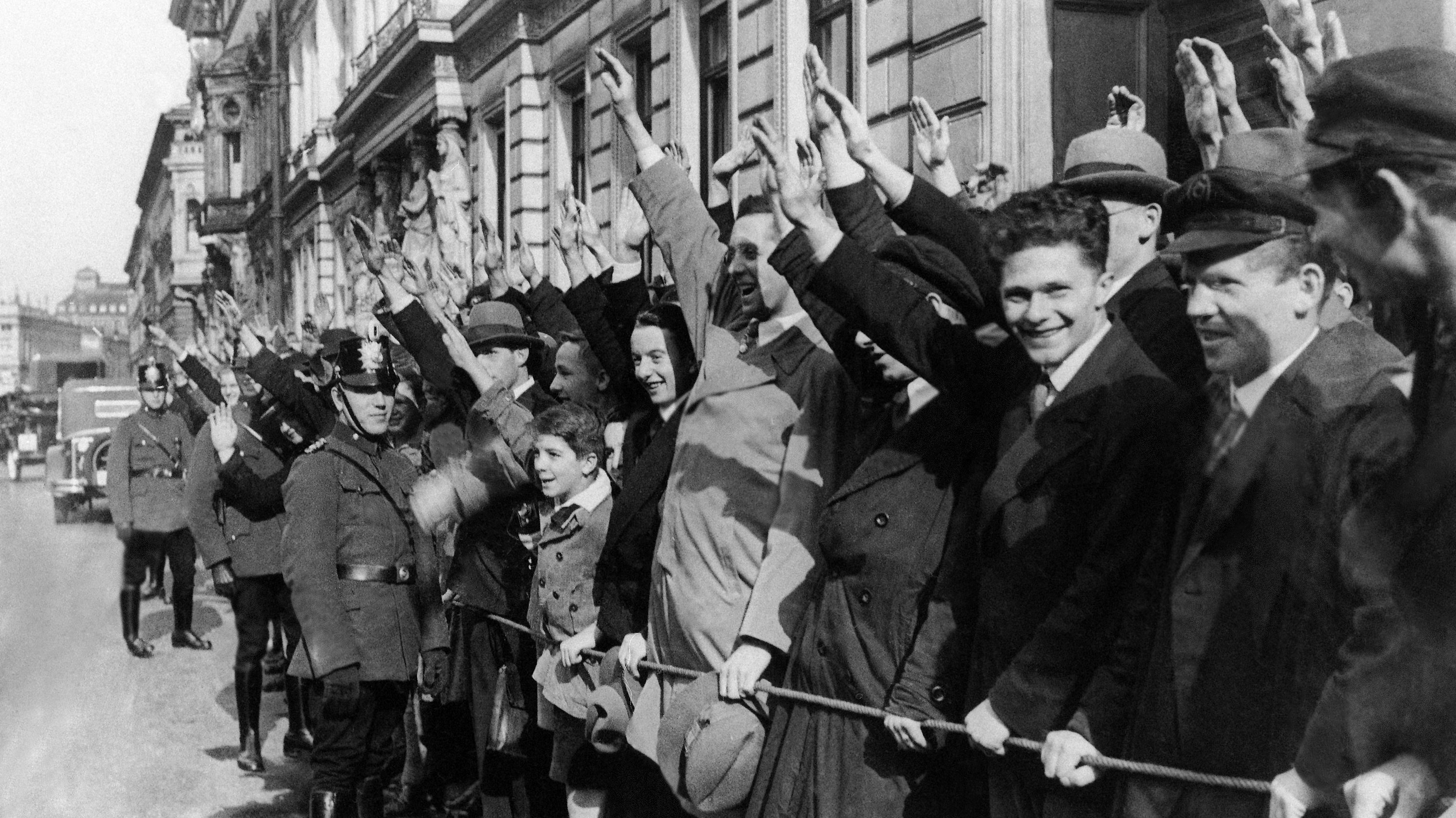 The National Socialists cheering Adolf Hitler's car in Germany on Oct. 10, 1931. President Von Hindenburg has received the first visit of Adolf Hitler. (AP Photo)