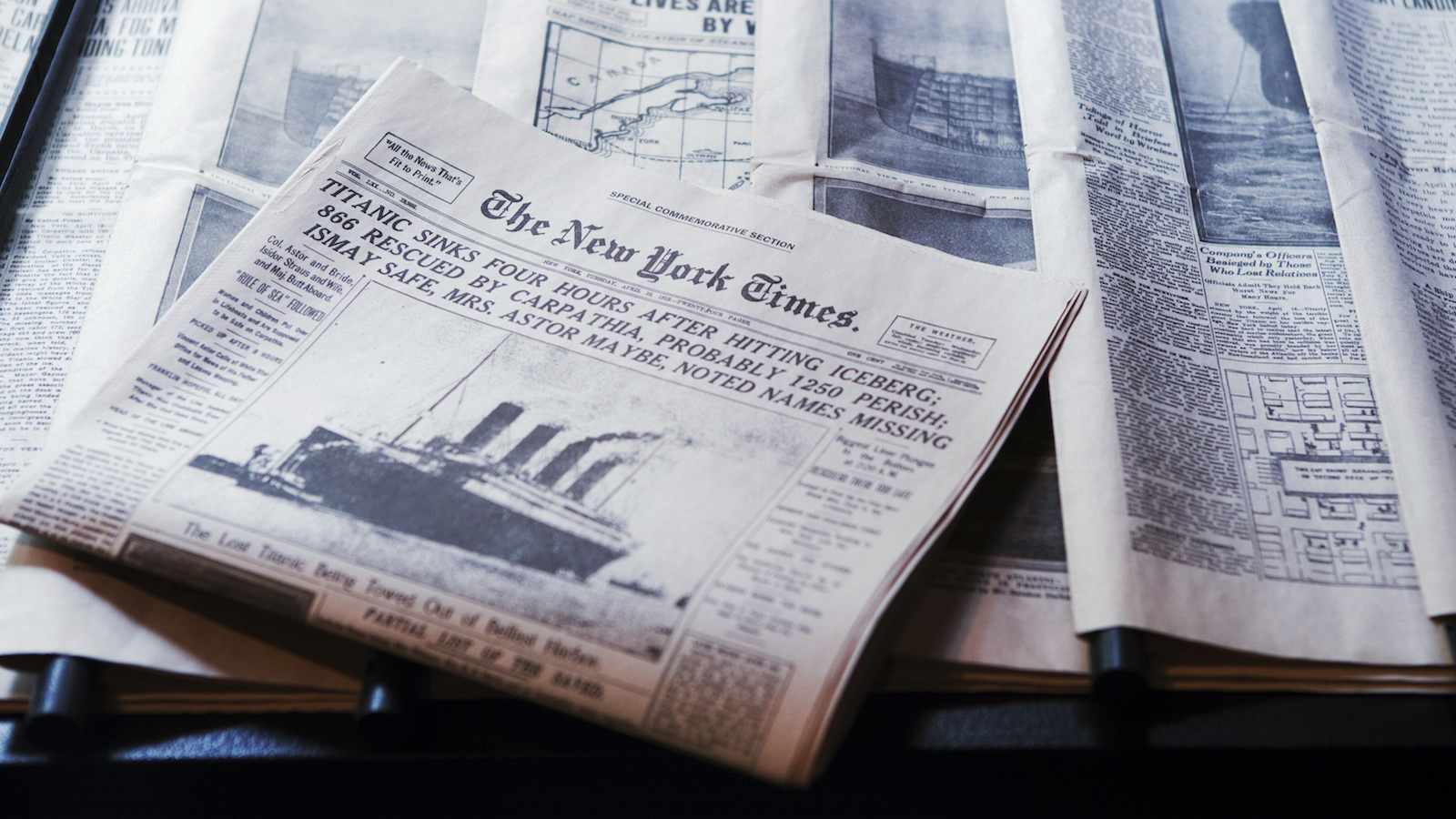 Copies of original newspapers describing the sinking of the Titanic rest in an exhibit at the South Street Seaport Museum commemorating the 100th anniversary of the sinking of the Titanic in New York April 11, 2012. REUTERS/Lucas Jackson (UNITED STATES - Tags: DISASTER SOCIETY MARITIME TRANSPORT) - RTR30LTN