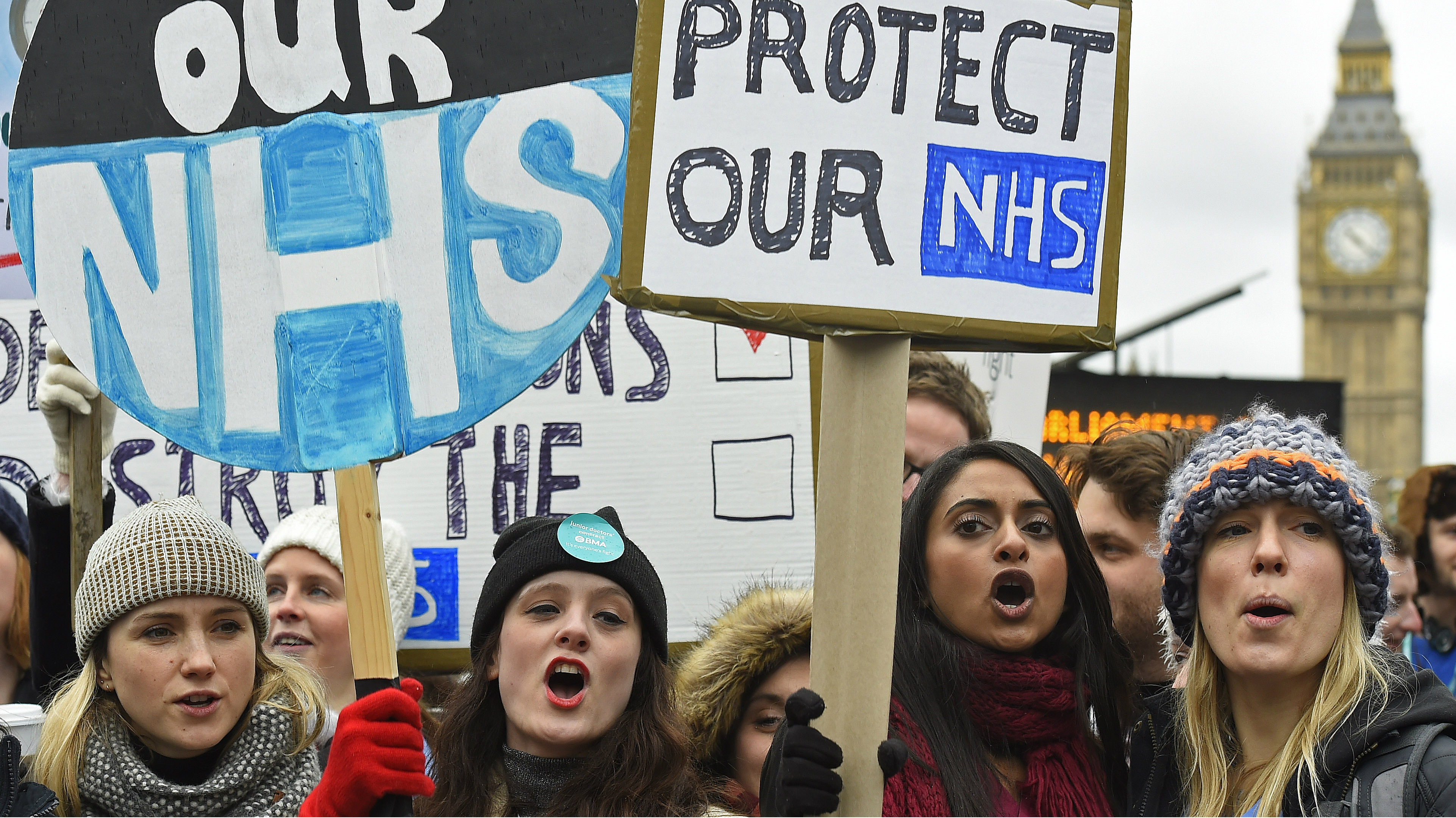 Junior doctors and NHS staff hold placards during a strike outside St Thomas' Hospital in London, Britain February 10, 2016. English doctors staged their second 24-hour strike on Wednesday over government plans to reform pay and conditions for working anti-social hours, in a move health chiefs have warned could put patients' lives at risk.