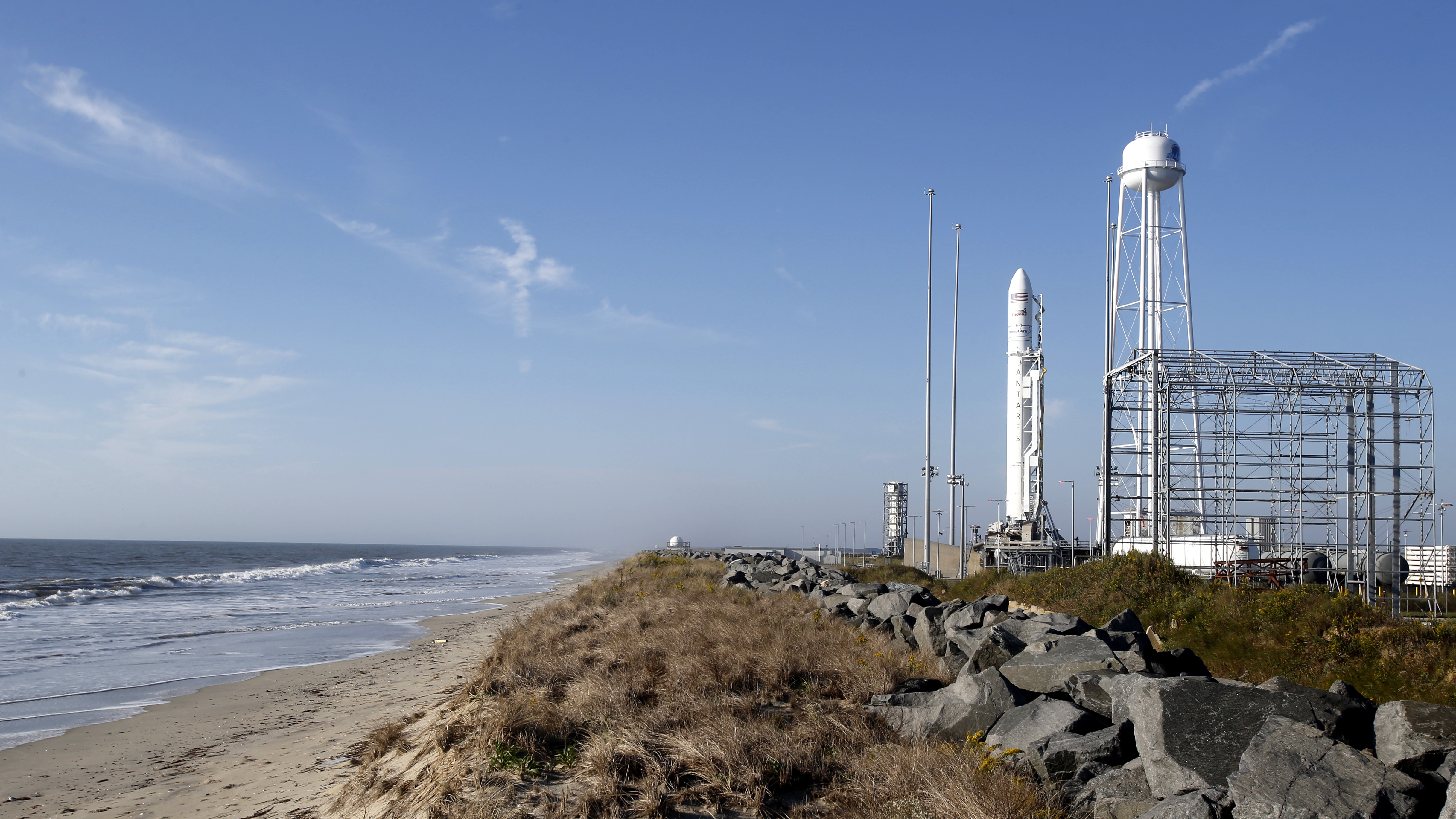 Workers do final preparations for the launch of Orbital ATK Antares rocket at the NASA Wallops Island flight facility in Wallops Island, Va., Monday, Oct. 17, 2016.  The rocket is carrying 5,100 lbs of supplies to the International Space Station.  The launch is scheduled to take place at 7:40PM Monday evening.