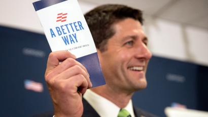 House Speaker Paul Ryan of Wis. holds up a pamphlet during a news conference on Capitol Hill in Washington, Tuesday, Sept. 27, 2016, following a closed-door meeting of House Republicans.