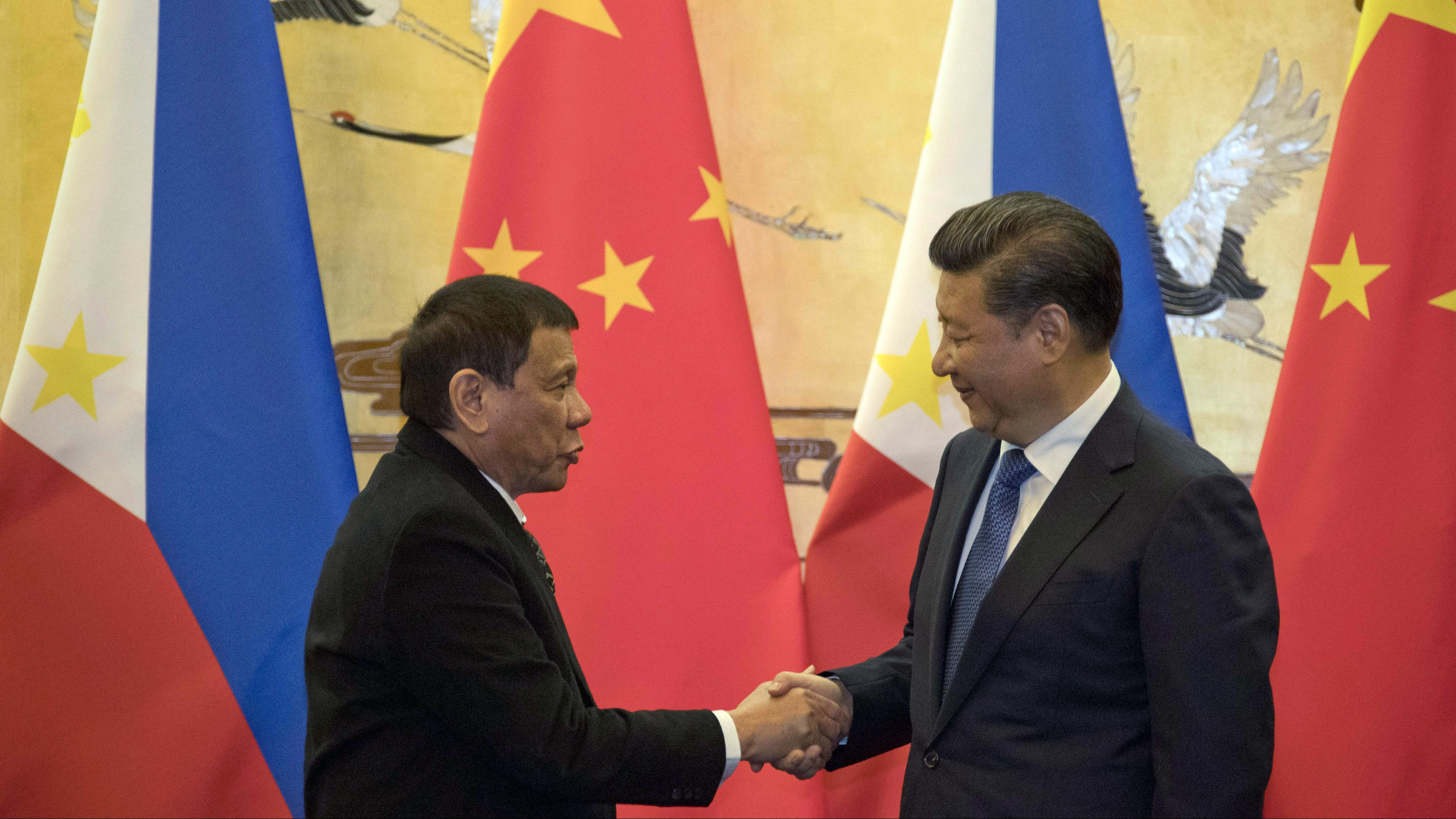 Philippine President Rodrigo Duterte, left, and Chinese President Xi Jinping shake hands after a signing ceremony in Beijing, China.