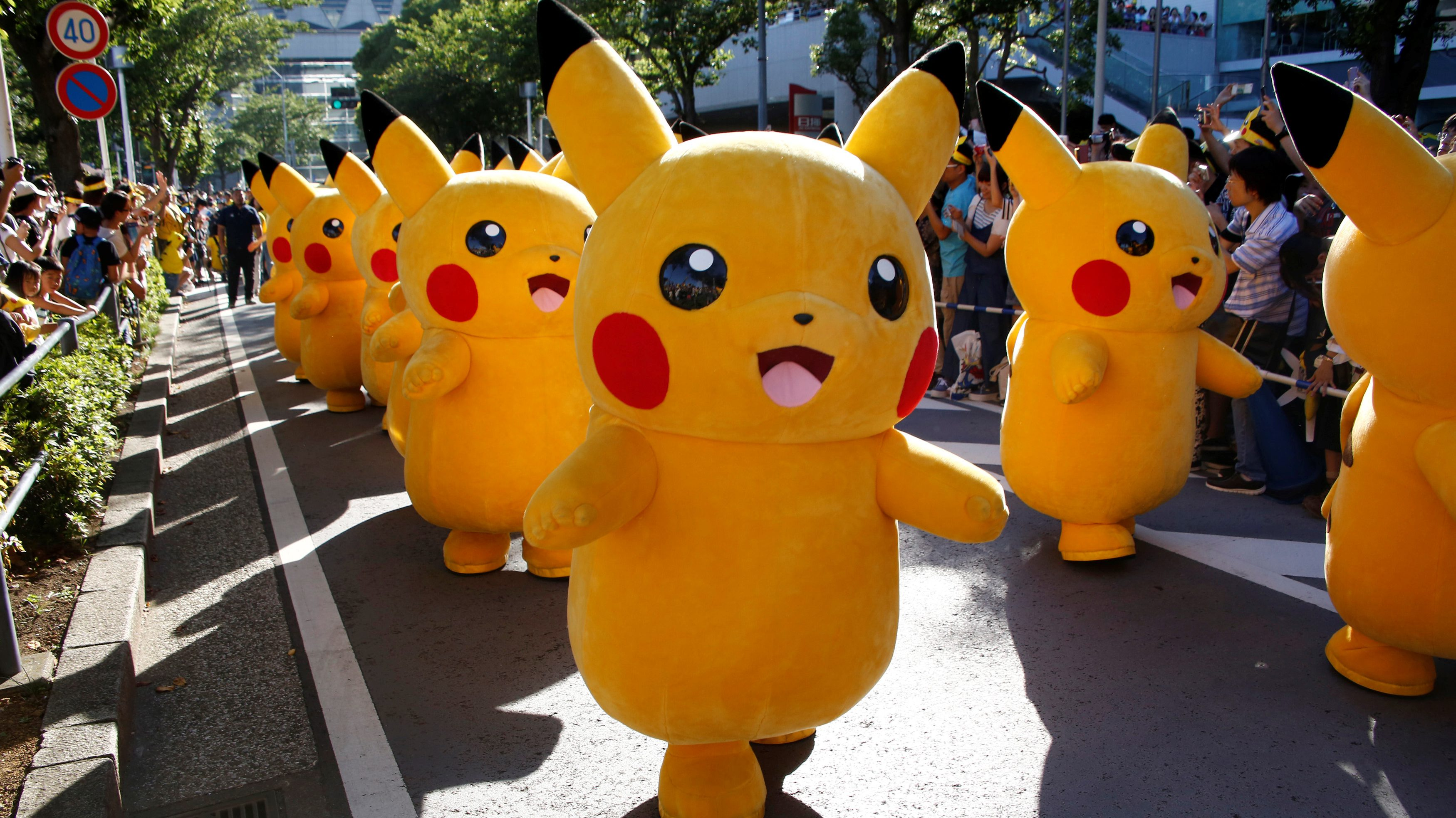 Performers wearing Pokemon's character Pikachu costumes take part in a parade in Yokohama, Japan, August 7, 2016.