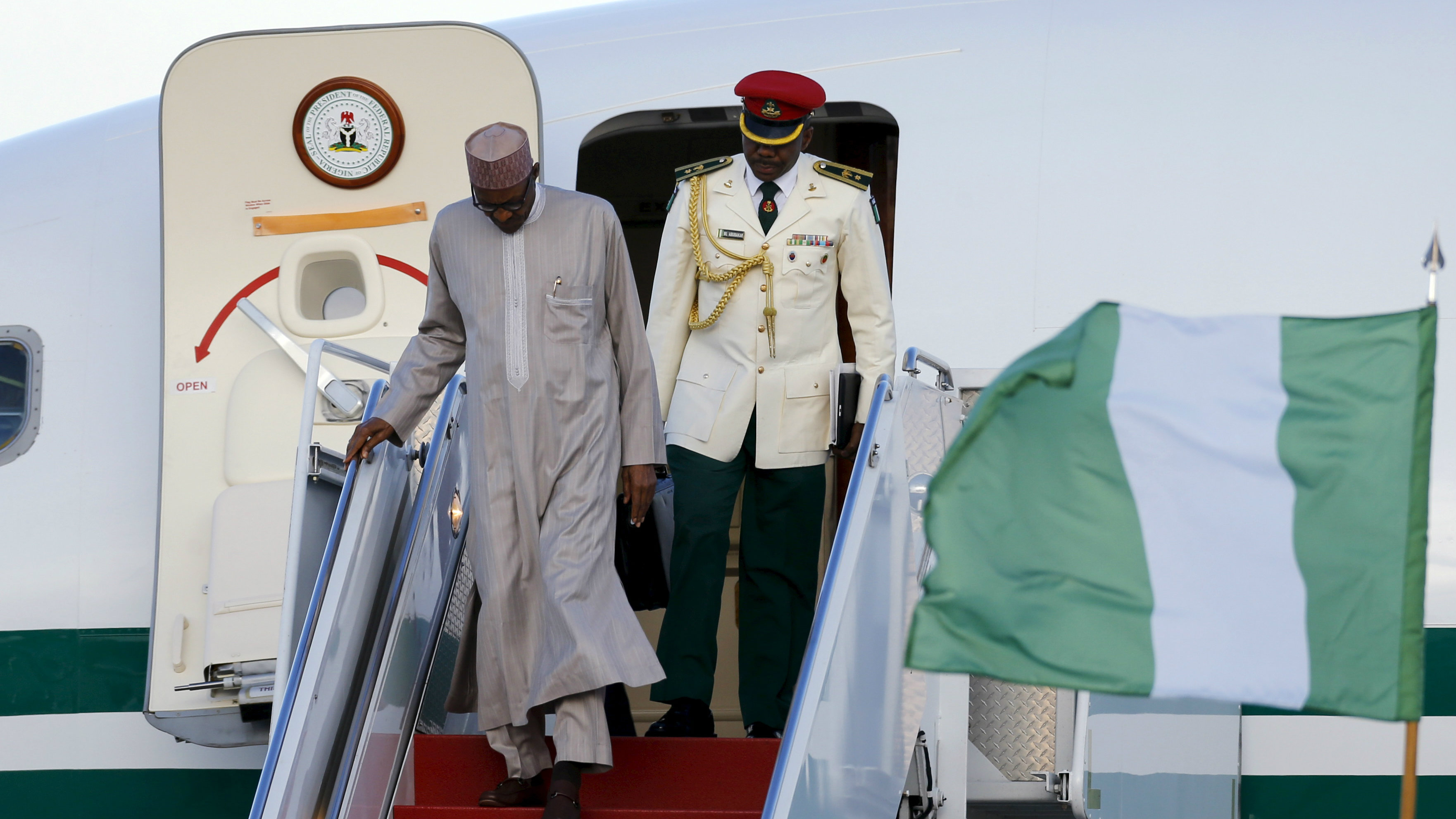 Nigeria's President Muhammadu Buhari (L) arrives on his official plane to attend the upcoming Nuclear Security Summit meetings in Washington, on the tarmac at Joint Base Andrews, Maryland March 30, 2016