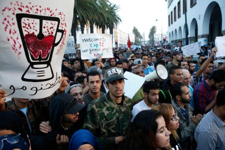 With graphic posters and signs some thousands of Moroccans protest against the death of Mouhcine Fikri last Friday, in the northern city of Hoceima in Rabat, Morocco,