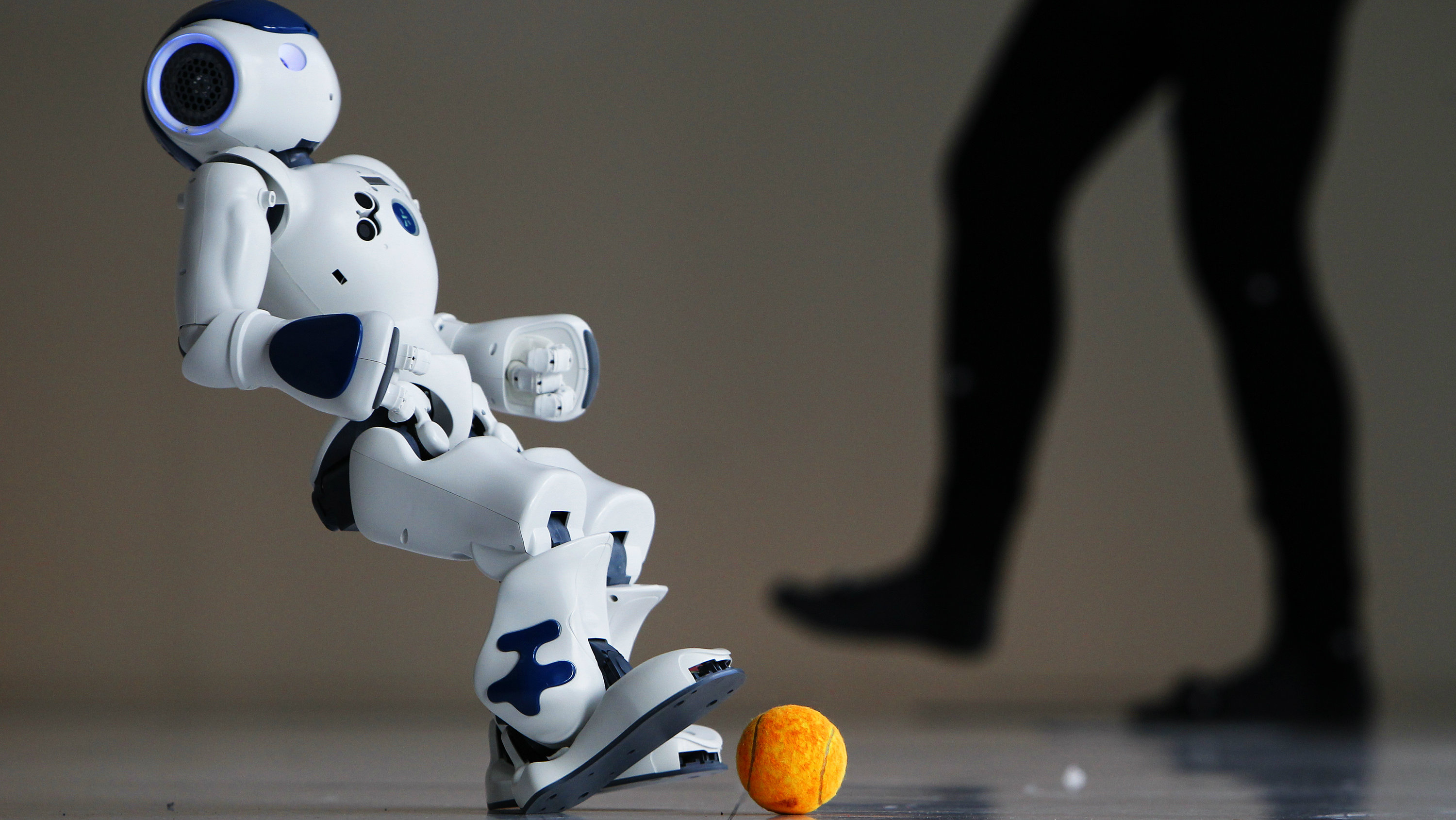 A robot from Android FC, a three-robot soccer team from the School of Infomatics at the University of Edinburgh, shows off its skills during a photocall for their upcoming show in the Edinburgh International Science Festival in Edinburgh, Scotland April 1, 2010. The robot soccer players are fully autonomous and have embedded processors that enable them to make sense of their surroundings and react to the movements of other players. REUTERS/David Moir(BRITAIN)