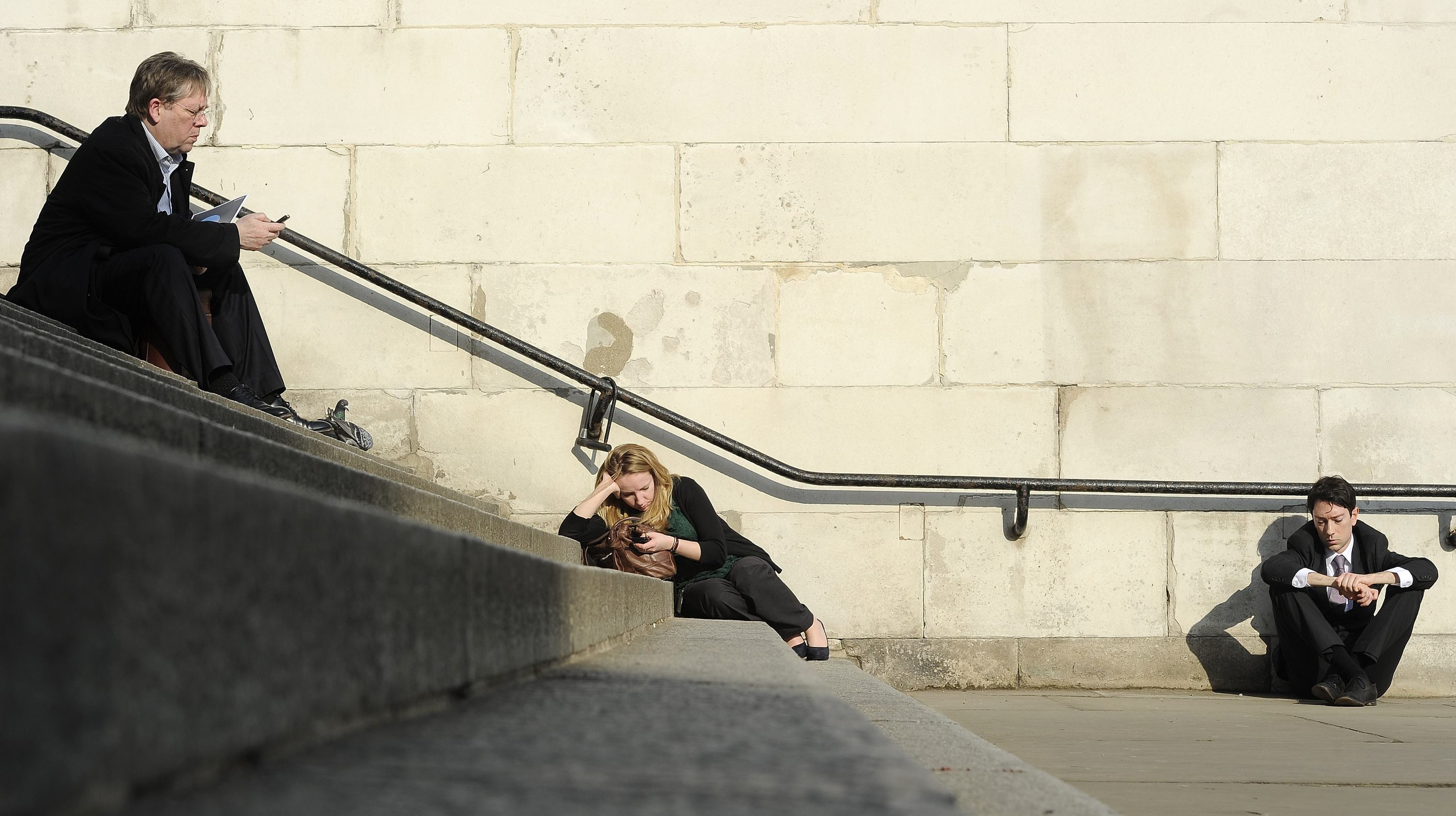 People sit in the sunshine in central London March 1, 2012.