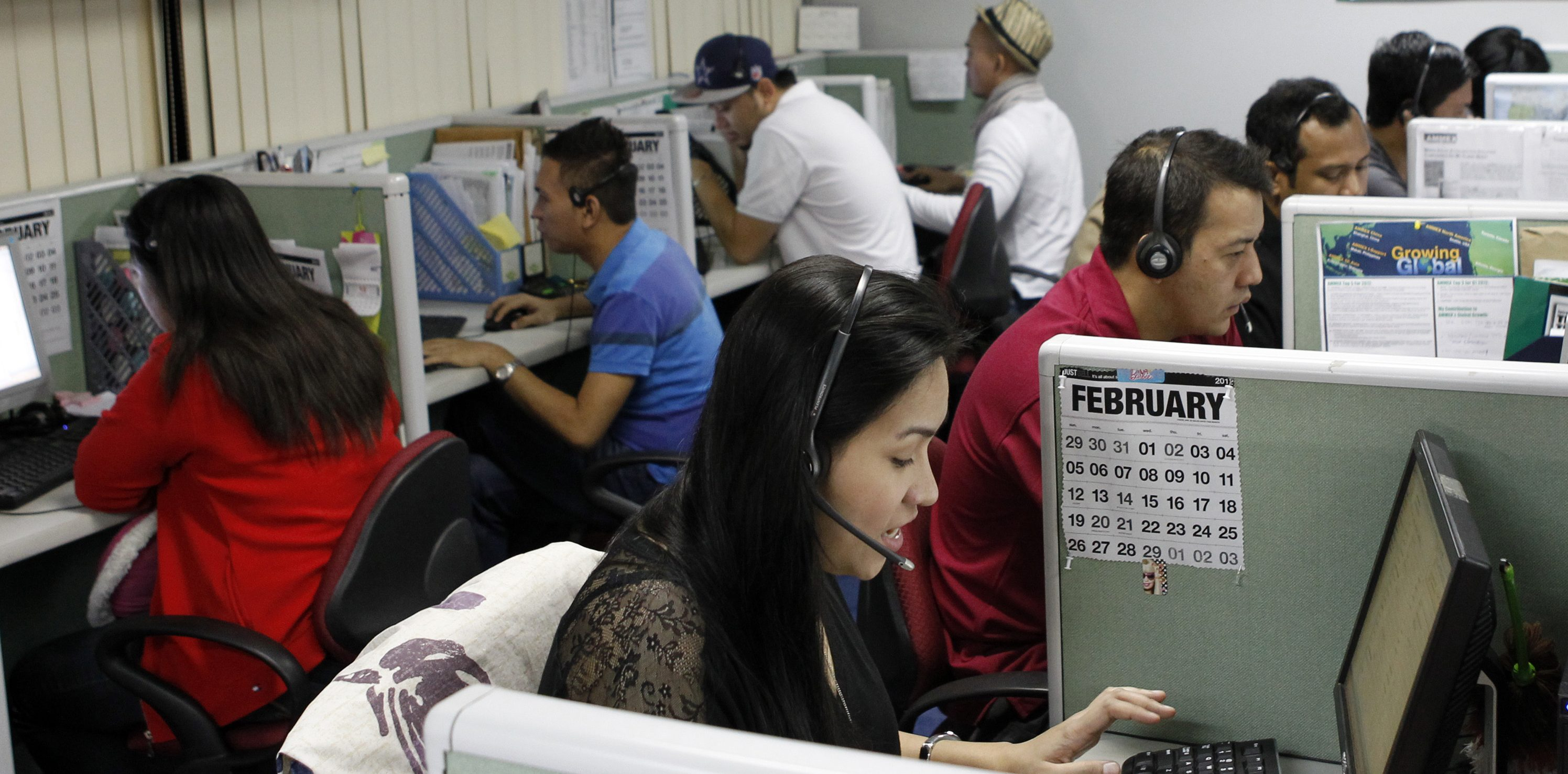 Call center agents work overnight daily to cater to United States clients in Manila's Makati financial district February 6, 2012. The number of Filipinos who work graveyard shifts to answer calls on behalf of big multinational companies like Citigroup and JPMorgan Chase is now greater than India's 350,000, earning the Philippine's the title - Call Centre Capital of the World. By 2016, the Philippines wants to double the size of the local BPO market to $25 billion, employing 1.3 million workers from 640,000 at the end of 2011. But to be able to that the Southeast Asian nation must convince investors it has more to offer than a huge pool of english-speaking talent. Picture taken February 6, 2012.