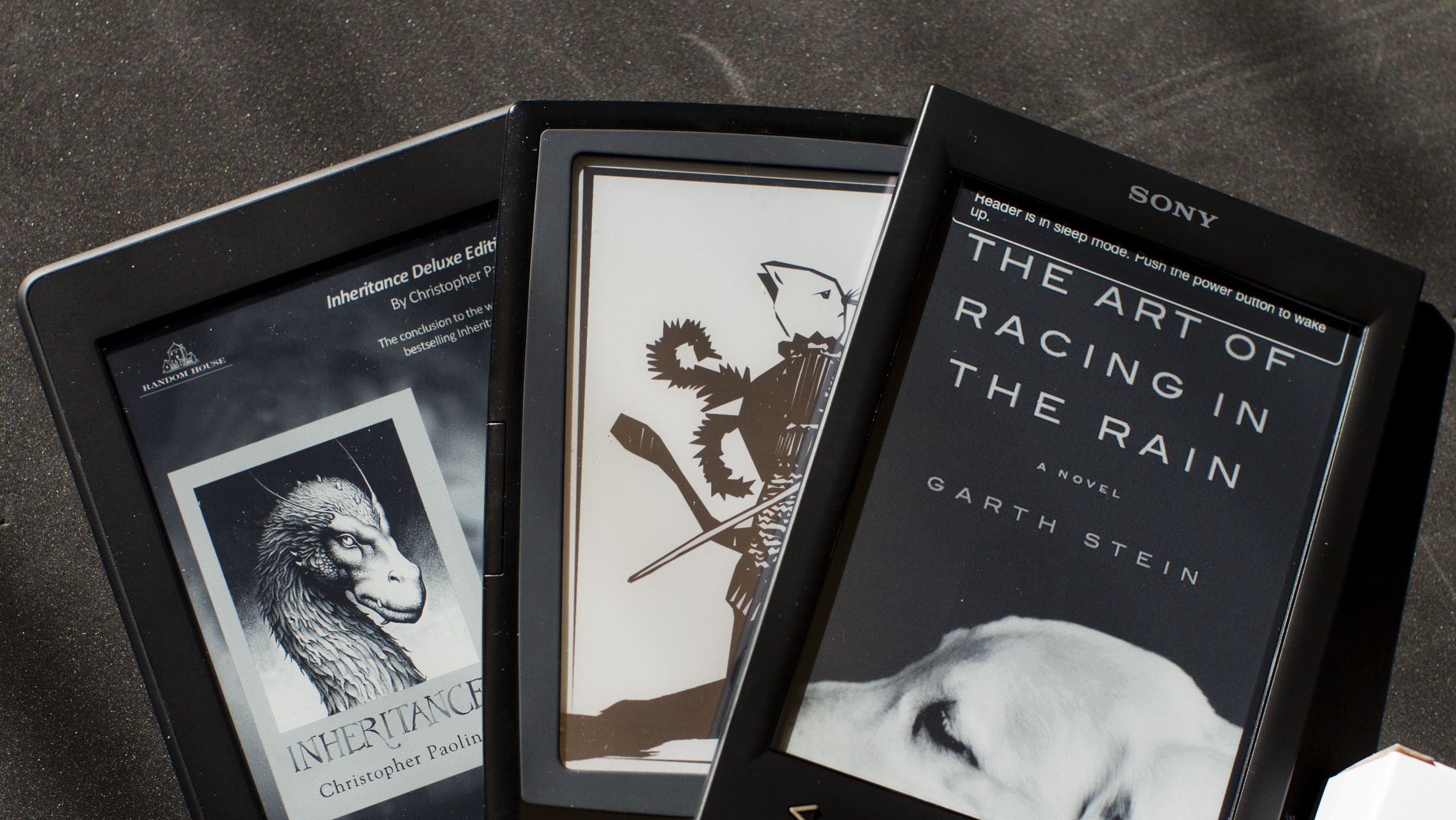 An Amazon Kindle (L-R), a Bookeen Cybook Odyssey, and a Sony Reader, all of which use technology developed by E Ink, are pictured at E Ink Corporation in Cambridge, Massachusetts October 25, 2012. Amidst our growing love affair with the tablet, spare a thought for its increasingly shelfbound sibling: the e-reader. Take Taiwan's E Ink Holdings Inc, which makes most of the monochrome displays for devices such as Amazon.com Inc's Kindle and Barnes & Noble Inc's Nook. After five years of heady growth during which shipments rose 100-fold, it got a jolt at the end of 2011 when monthly revenues dropped 91 percent in two months. E-readers initially benefited from their reflective displays, which can be read in sunlight and require very little power. But the success of Apple Inc's iPad, improved backlit displays, power-saving technologies and new smaller tablets all point to one thing: the e-reader has become a transitional technology. Picture taken October 25, 2012. To match Analysis EREADERS-FUTURE/      REUTERS/Dominick Reuter  (UNITED STATES - Tags: SCIENCE TECHNOLOGY BUSINESS) - RTR39PLH