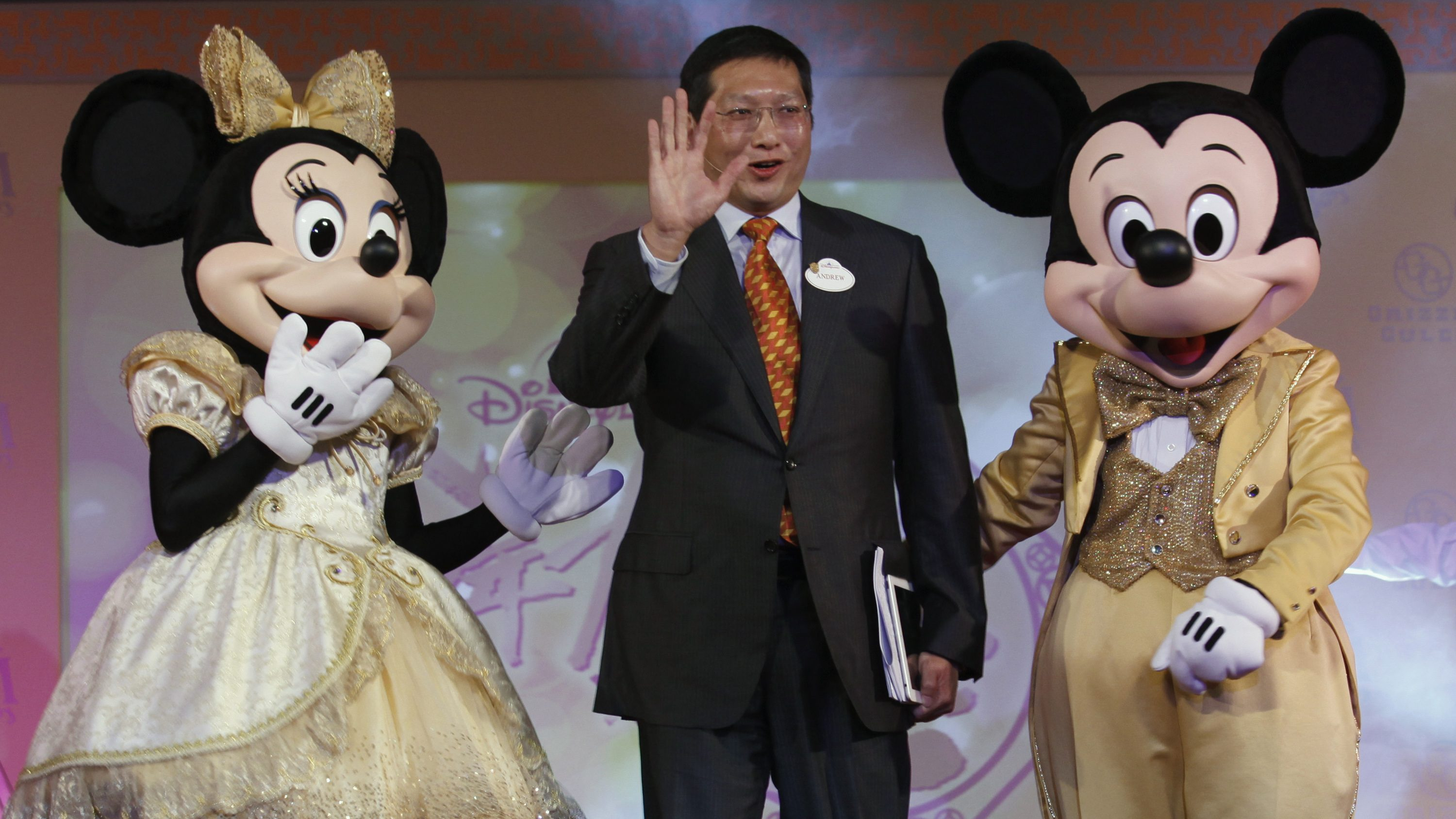 Hong Kong Disneyland Managing Director Andrew Kam (C) attends a news conference in Hong Kong February 18, 2013. Hong Kong Disneyland on Monday reported a net profit of HK$109 million (13.97 million) for the financial year that ended on September 29, 2012, the first annual profit since the resort opened in September 2005.