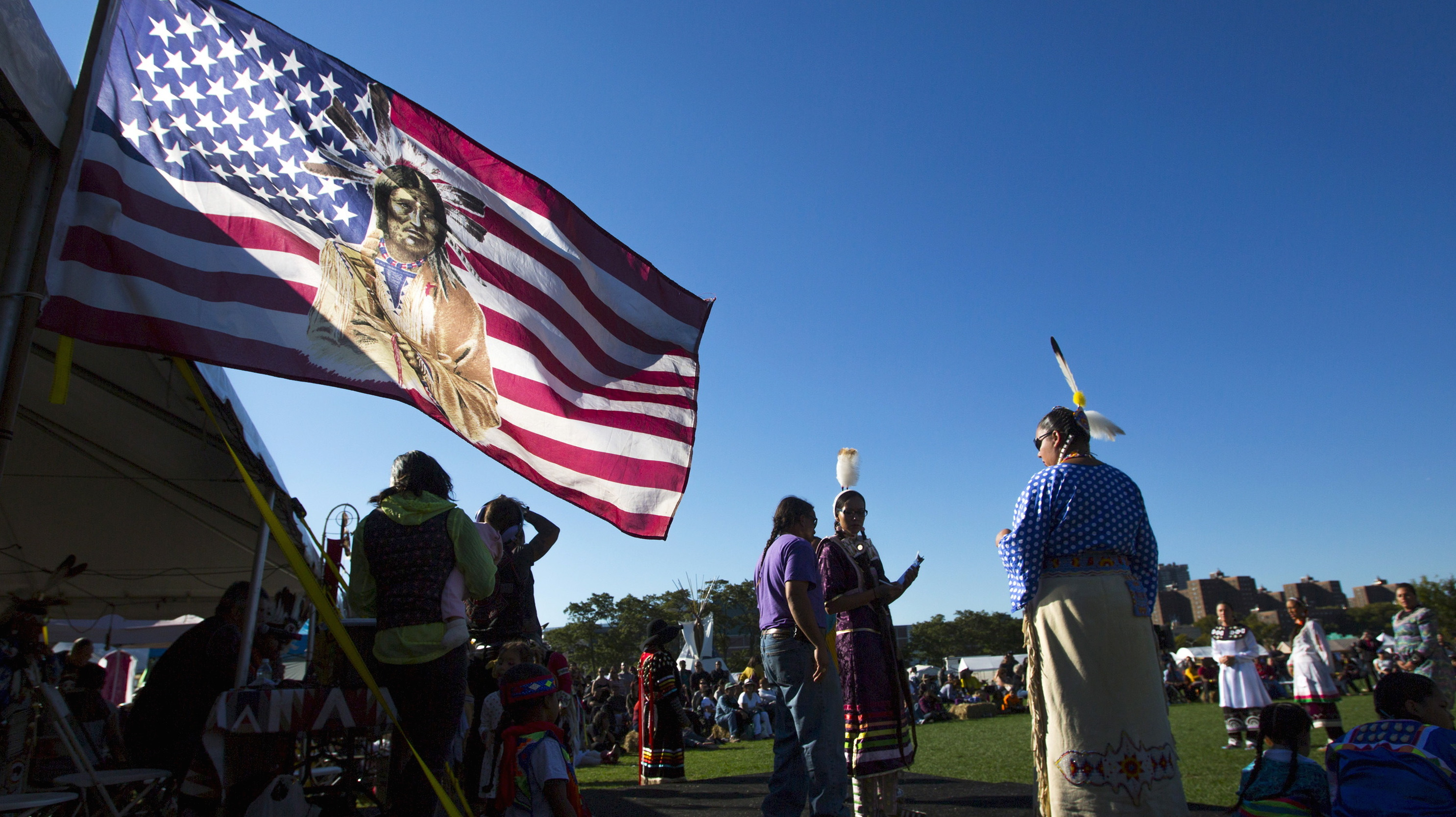 """Revellers take part during a """"pow-wow"""" celebrating the Indigenous Peoples' Day Festival in Randalls Island, New York, October 11, 2015. The festival is held as a counter-celebration to Columbus Day and is to promote Native American culture and history."""