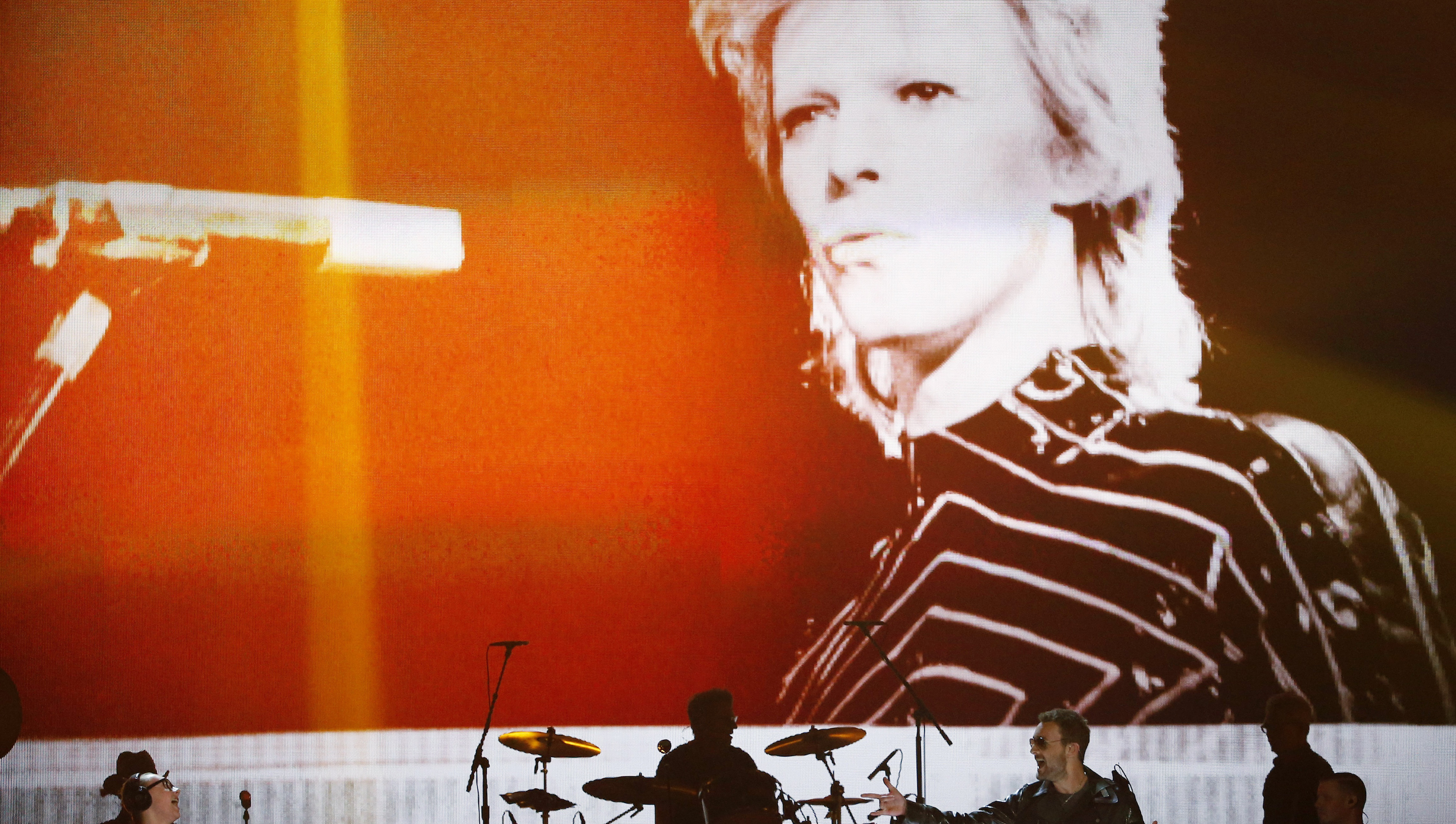 """Image of David Bowie is projected onstage as Eric Church performs """"Record Year"""" during the 51st Academy of Country Music Awards in Las Vegas, Nevada April 3, 2016.  REUTERS/Mario Anzuoni - RTSDF06"""