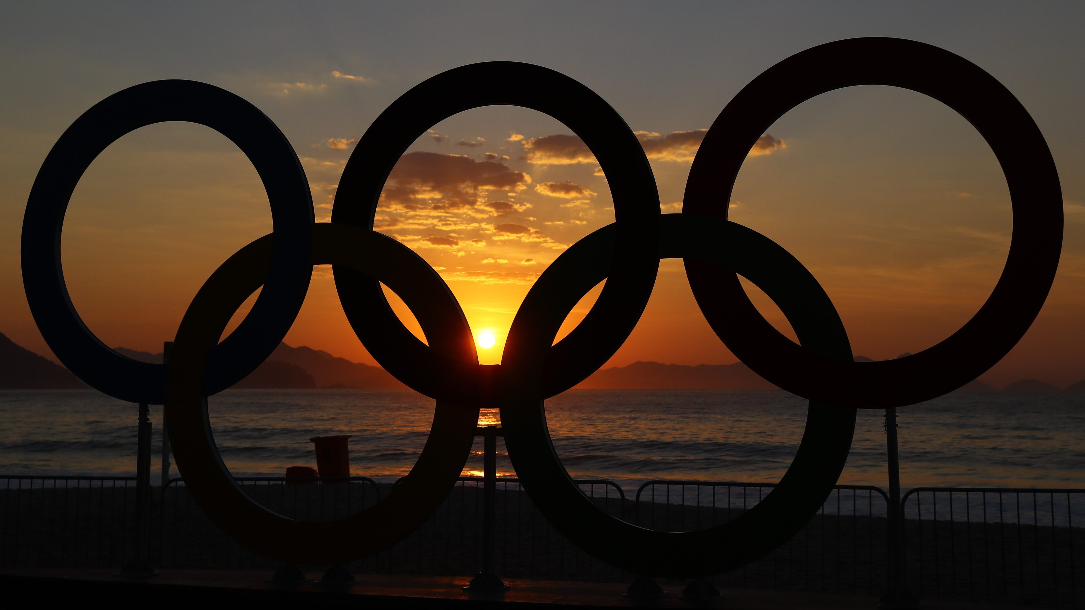 2016 Rio Olympics - Cycling Road - Final - Men's Road Race - Fort Copacabana - Rio de Janeiro, Brazil - 06/08/2016. The Olympic rings are seen as the sun rises over Fort Copacabana ahead of the Men's Road Race.     REUTERS/Paul Hanna  - RTSLDJV